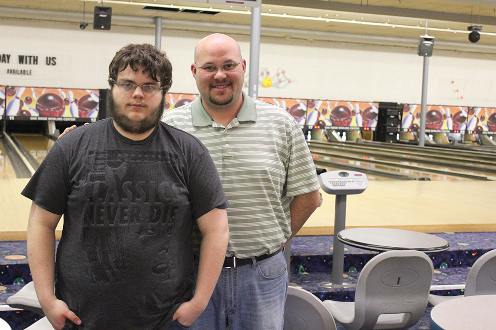 Tristan Cox with manager Craig Porter at Tristan's new job at the Oak Ridge Bowling Center.