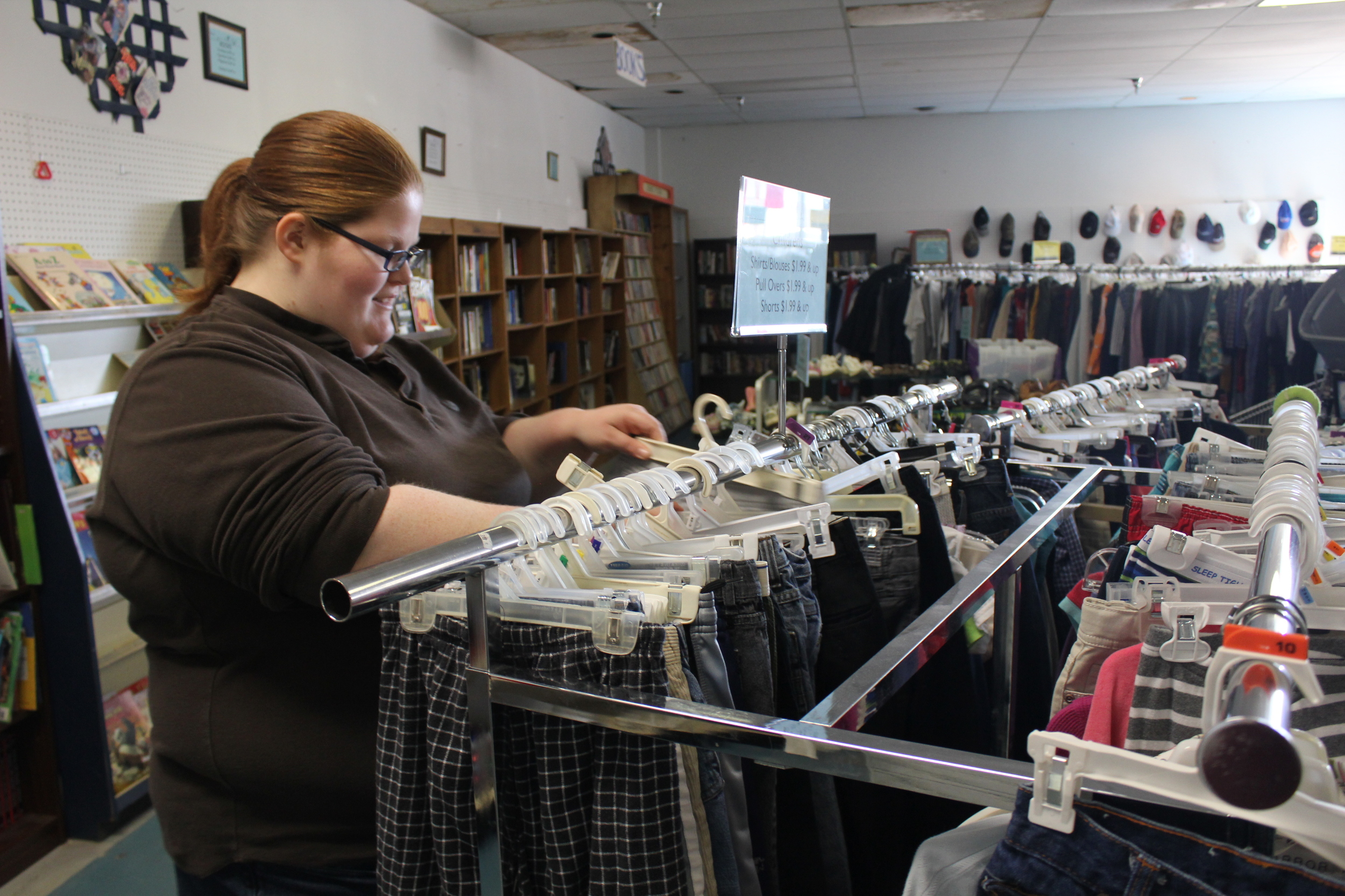 Maura Cadmus processes donations at the Oak Ridge retail store as part of her Work Adjustment Training. When her high school CDC partner visits, they work together on this task.