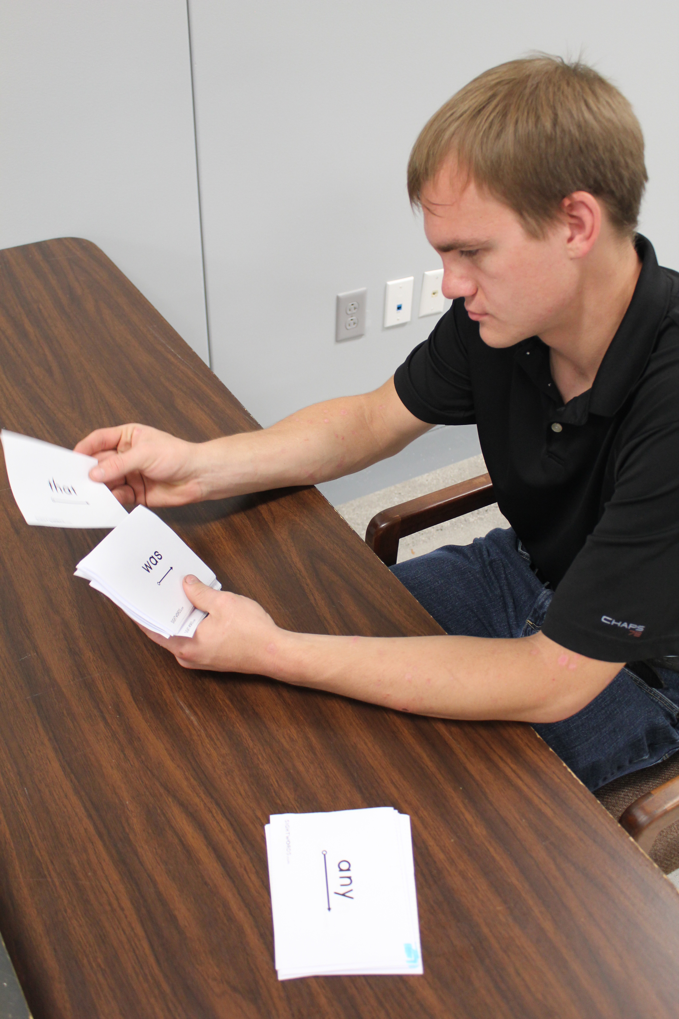 While most of Gunnar's work at Goodwill is computer-based, he also uses flash cards to test his reading skills.