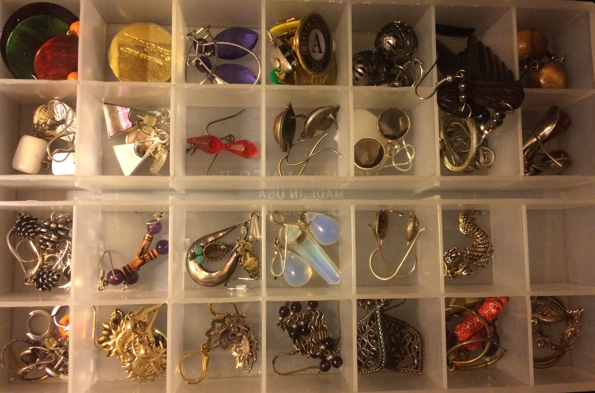 Jewelry - Everyone has their vices; I used to be a purse collector. I swapped to jewelry because it's timeless and it packs very small.Items that are out of sight tend to multiply! I'm currently building a jewelry organizer to make my collection visible. For now a thrifted monthly pill organizer works well!