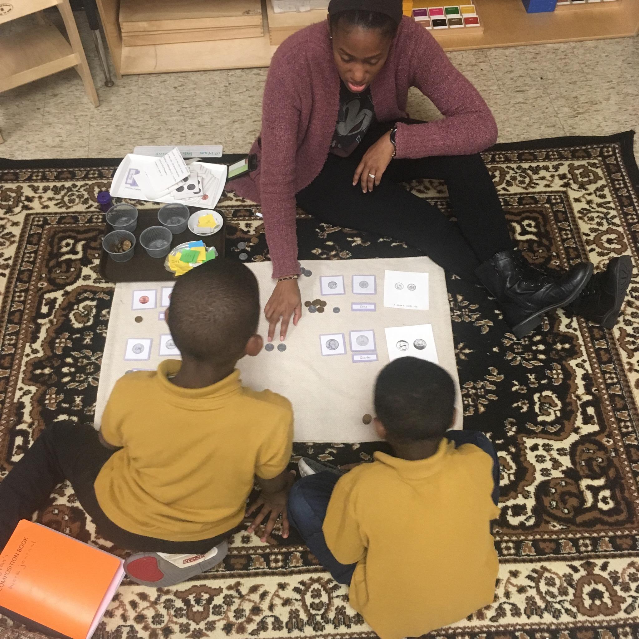 michaela joshua teaching math.JPG