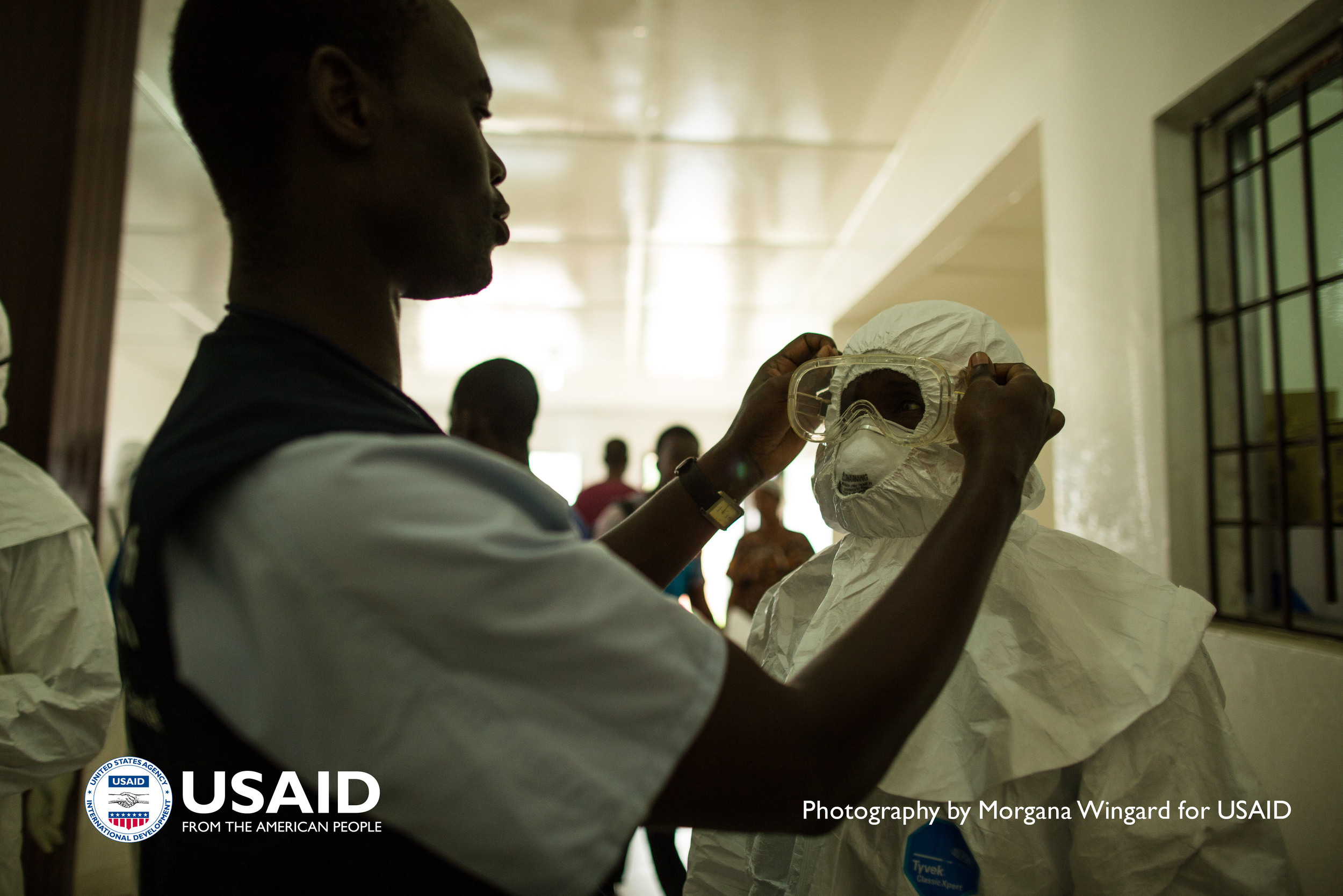 Health care workers put on personal protective equipment (PPE) before going into the hot zone at Island Clinic in Monrovia, Liberia on Sept. 22 2014. / Morgana Wingard, USAID