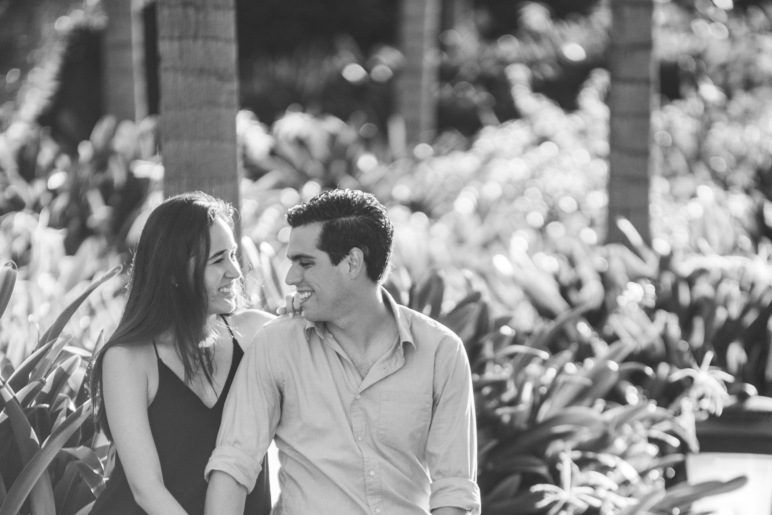Black and white photo of couple looking at each other in Mauritius