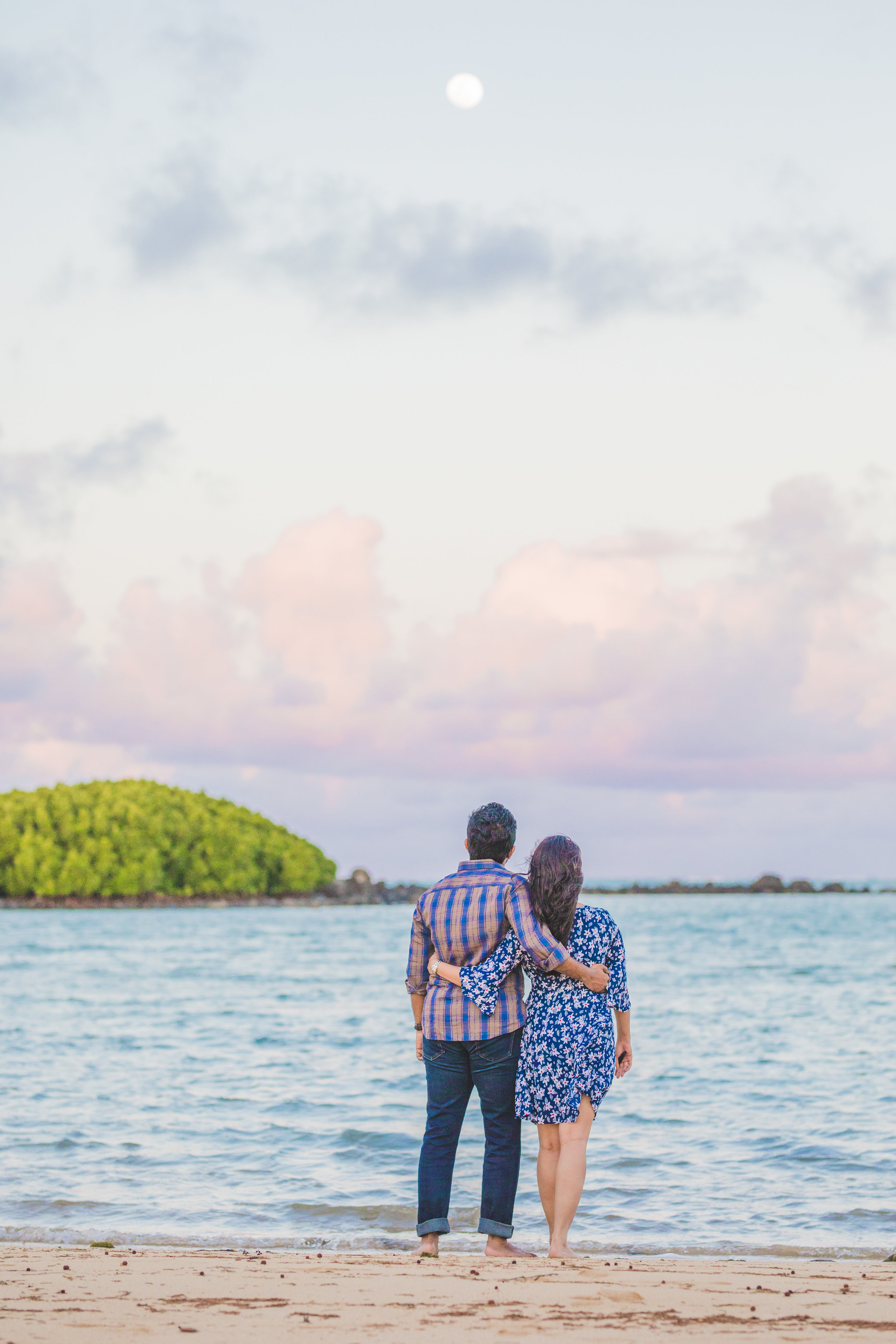Honeymoon couple looking at the moon at Azuri in Mauritius
