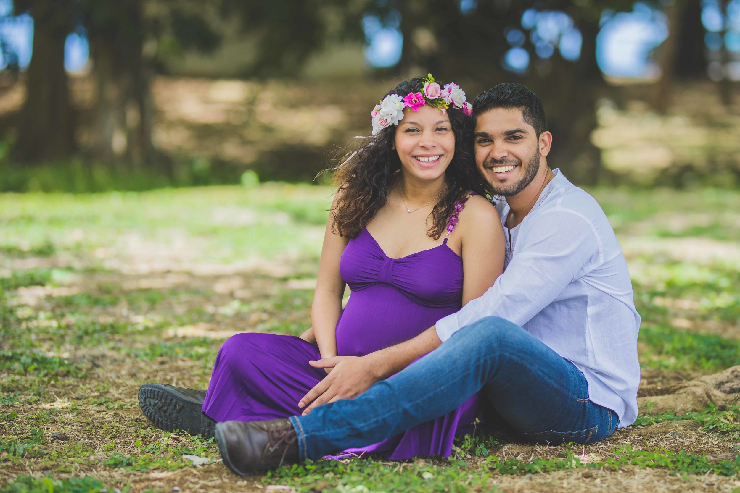 Couple similing Post Wedding Maternity photoshoot