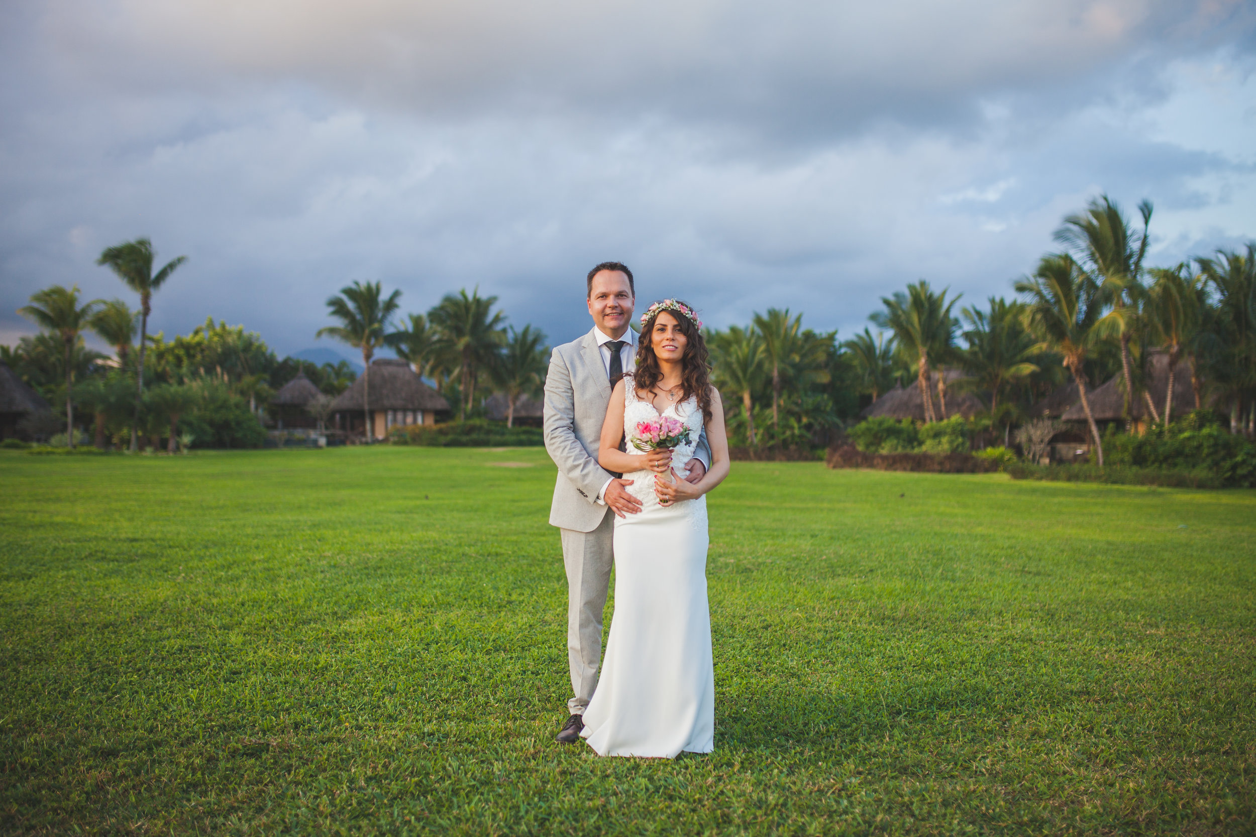 Married Couple posing in front of Shanti Maurice Villas