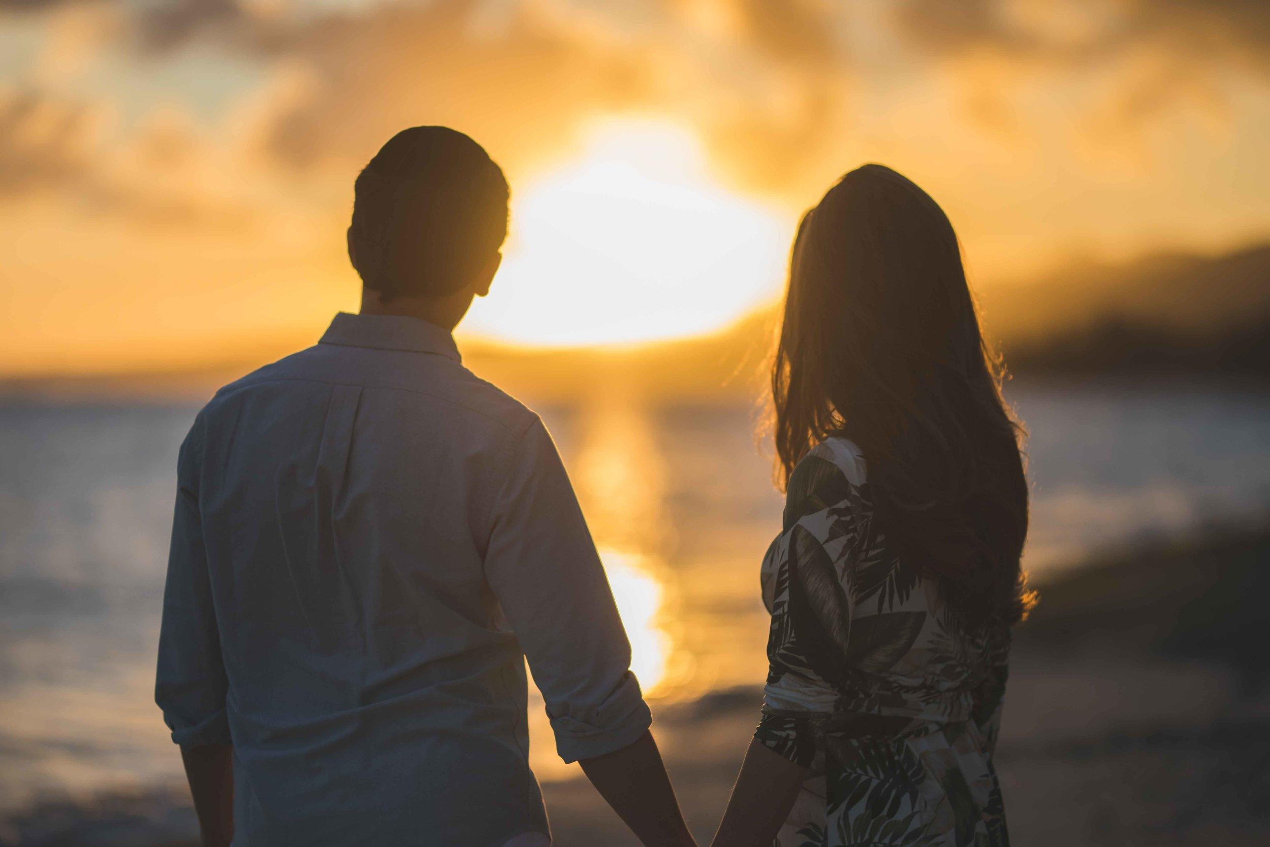 Couple facing sunset in Mauritius