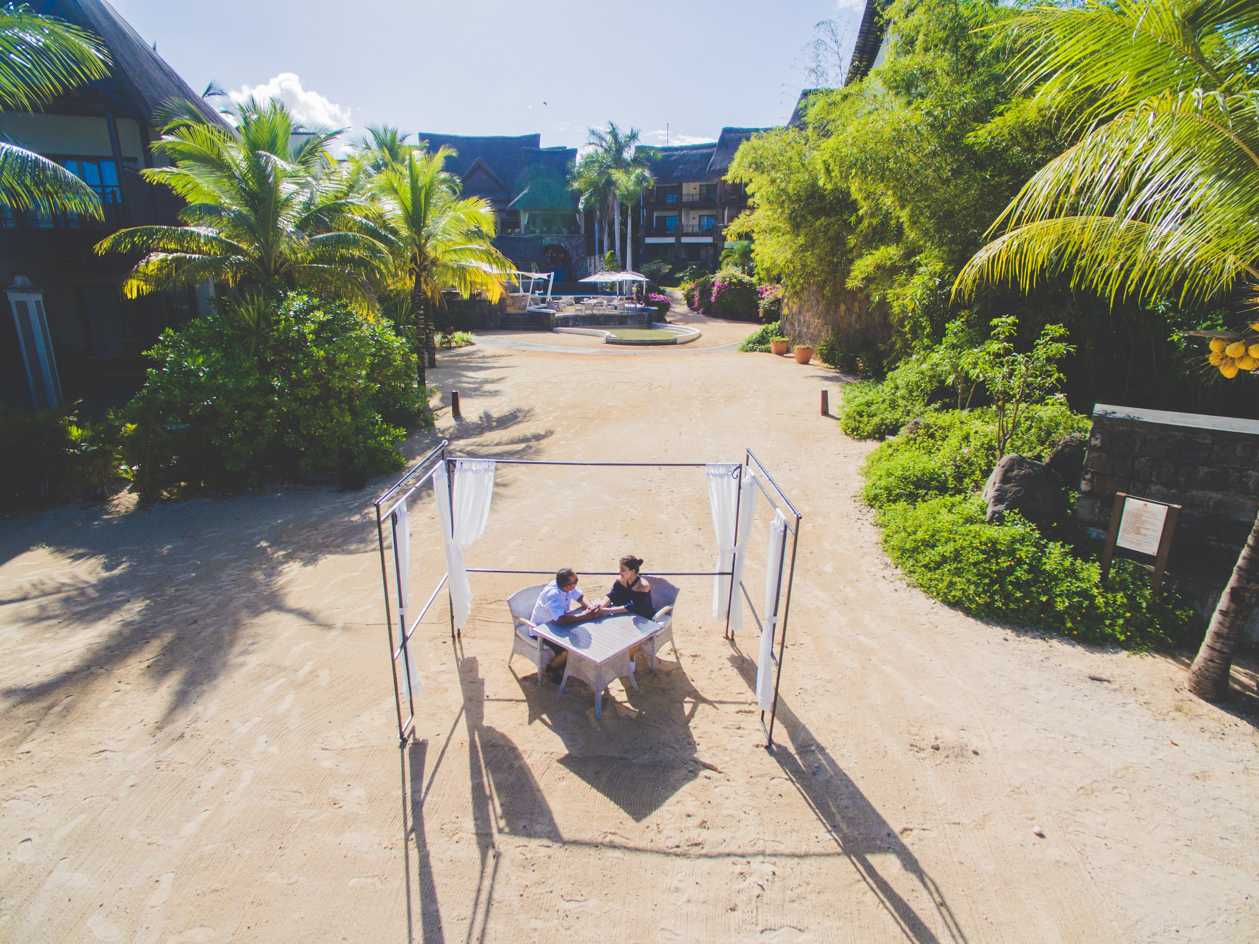 Drone photo of couple on a beach