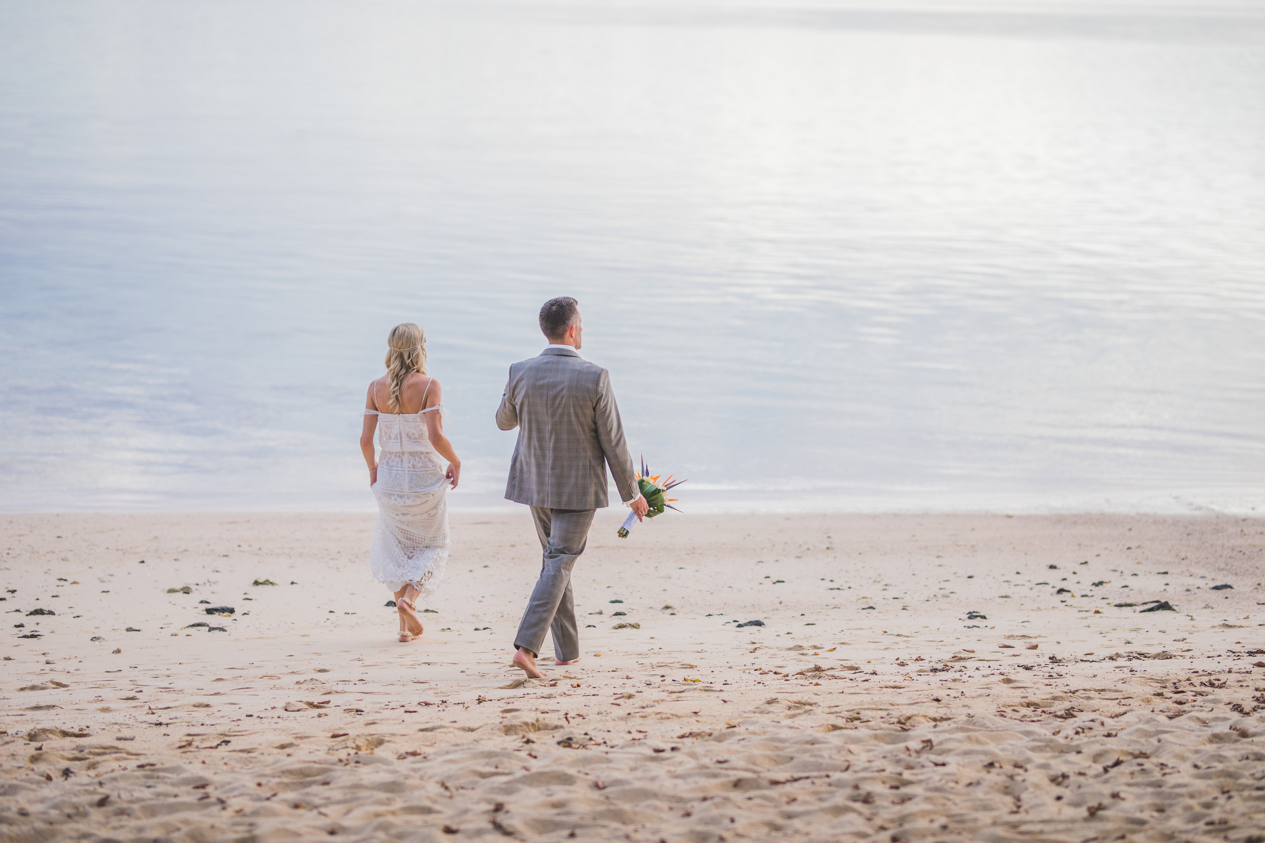 Bride and Groom walking barefoot on a beach in Mauritius