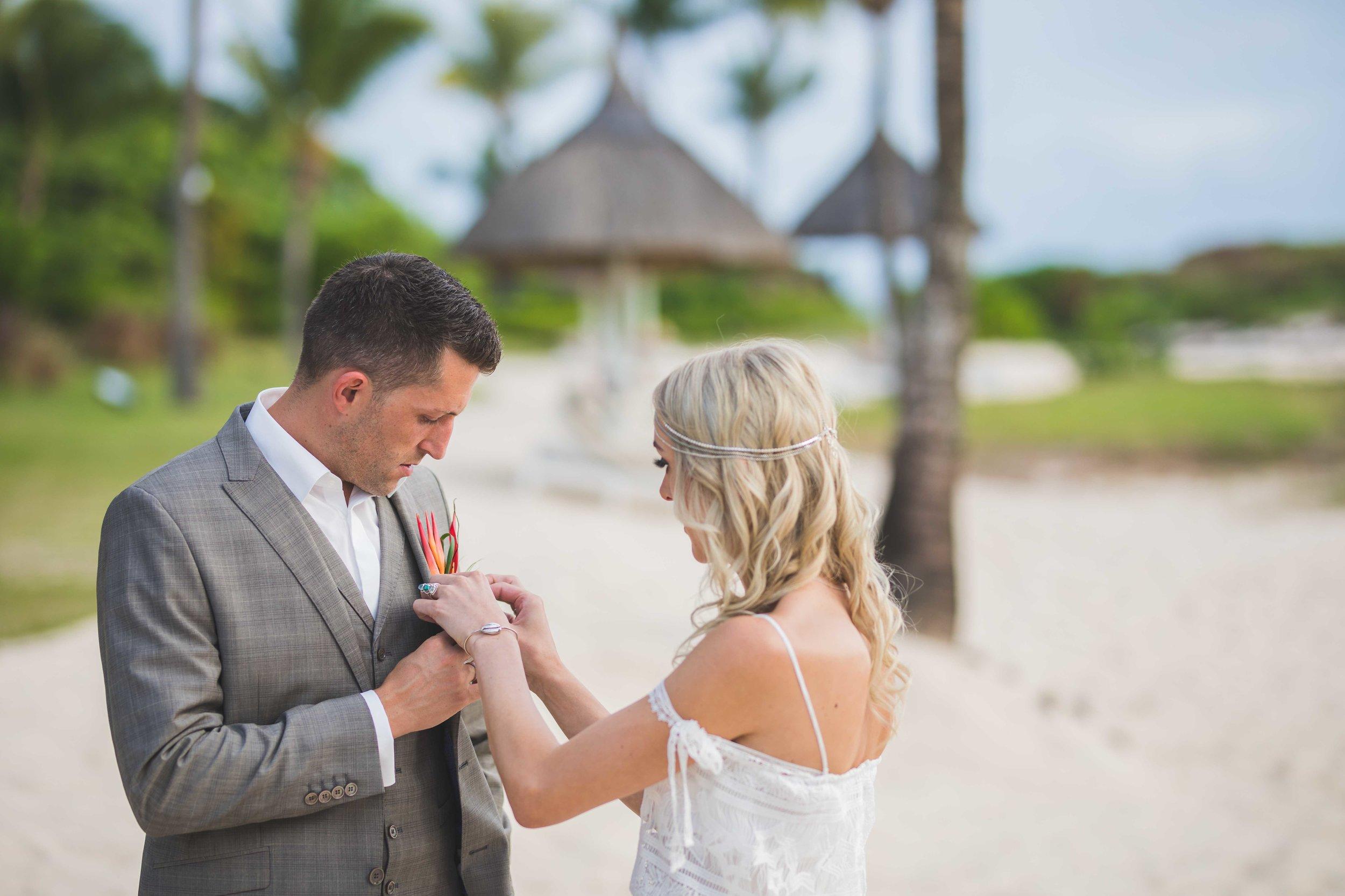 Bride Helping Groom with Flowers