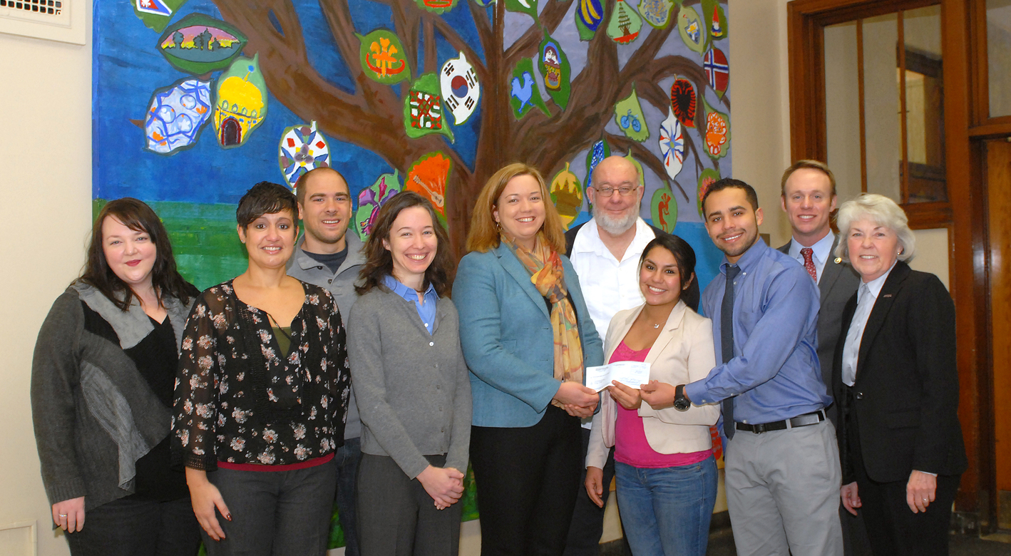 NEIU faculty and students providing a check for $6,080 to FoP for fire victims.