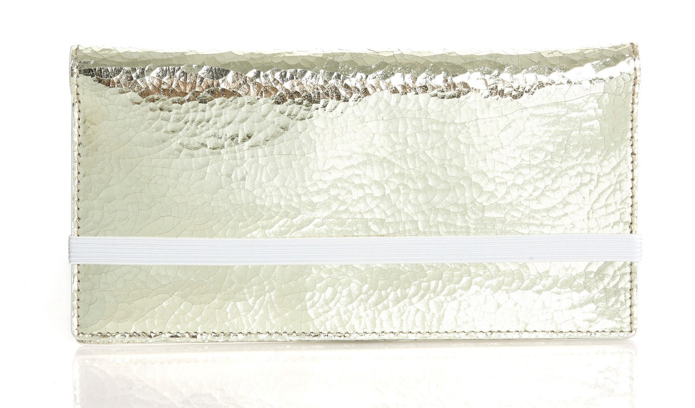 Add a spark to your look with this Gravedad wallet in silver. Very sleek.