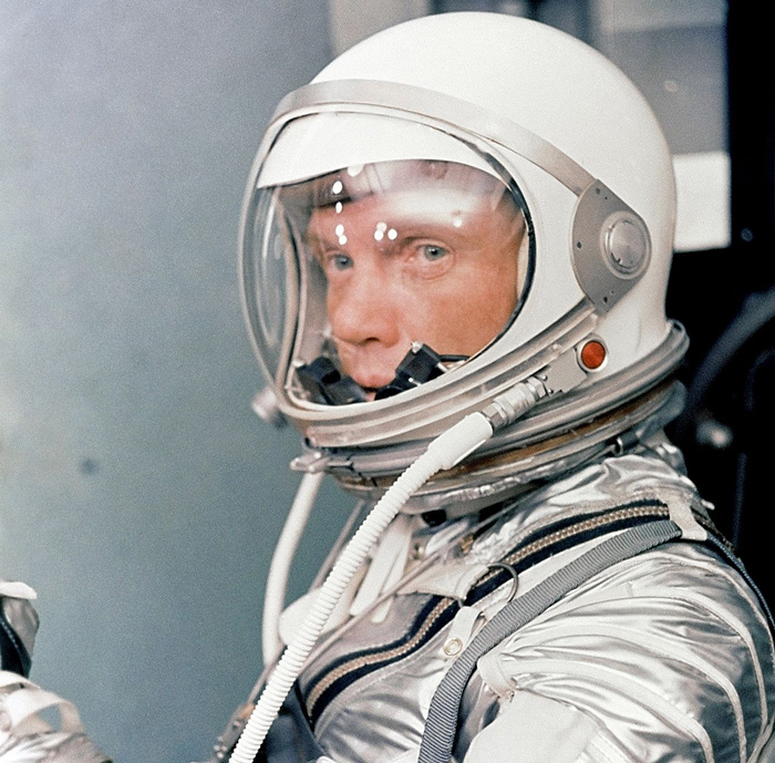 John Glenn with the final Mercury suit helmet, a design that was preceded by the prototype USN Mark IV.