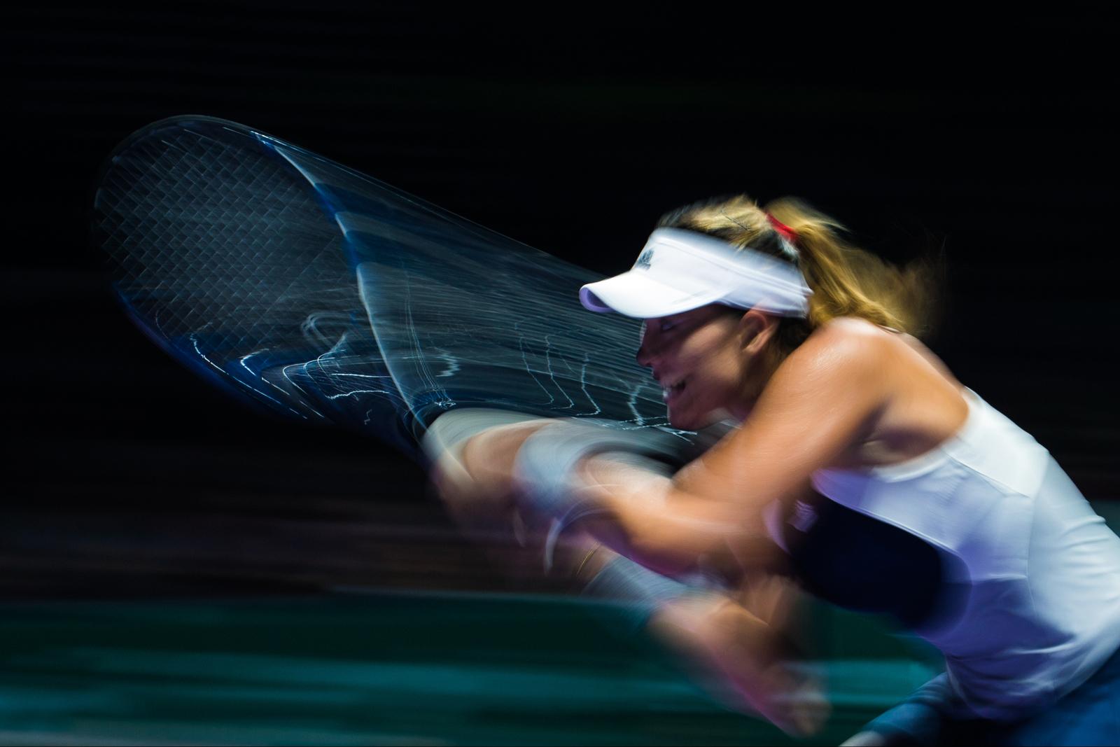 Garbine Muguruza of Spain in action against Agnieszka Radwanska of Poland during their singles semi-final match during the BNP Paribas WTA Finals at the Singapore Indoor Stadium on October 31, 2015 in Singapore.