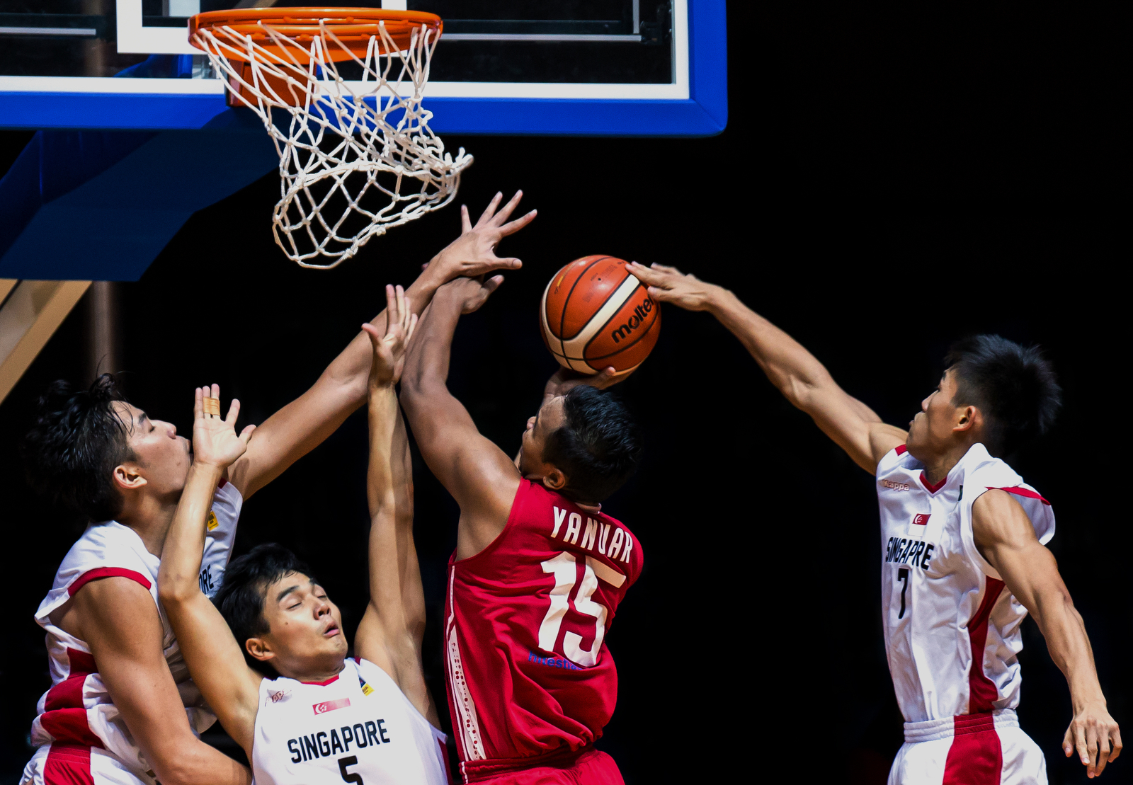 Yanuar Dwi Priasmoro (#15) of Indonesia goes for the layup against Singapore on day 3 of the 11th SEABA Championship at the OCBC Arena on April 29, 2015 in Singapore.