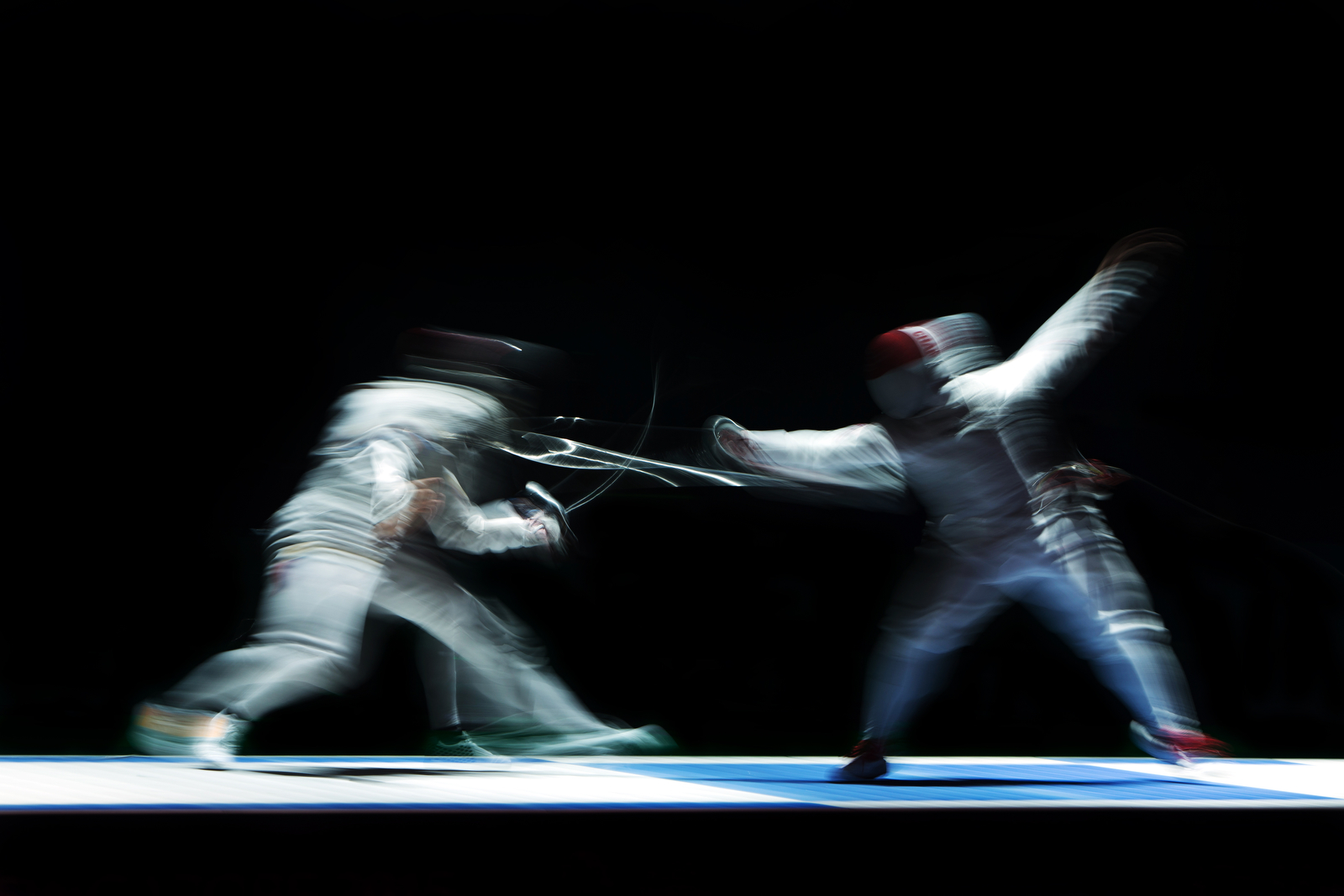 Kevin Jerrold Chan (R) of Singapore in action against Wilfred Richard Curioso of the Philippines during the men's team foil finals of the fencing competition at the 28th Southeast Asian Games at the OCBC Arena on June 7, 2015 in Singapore.