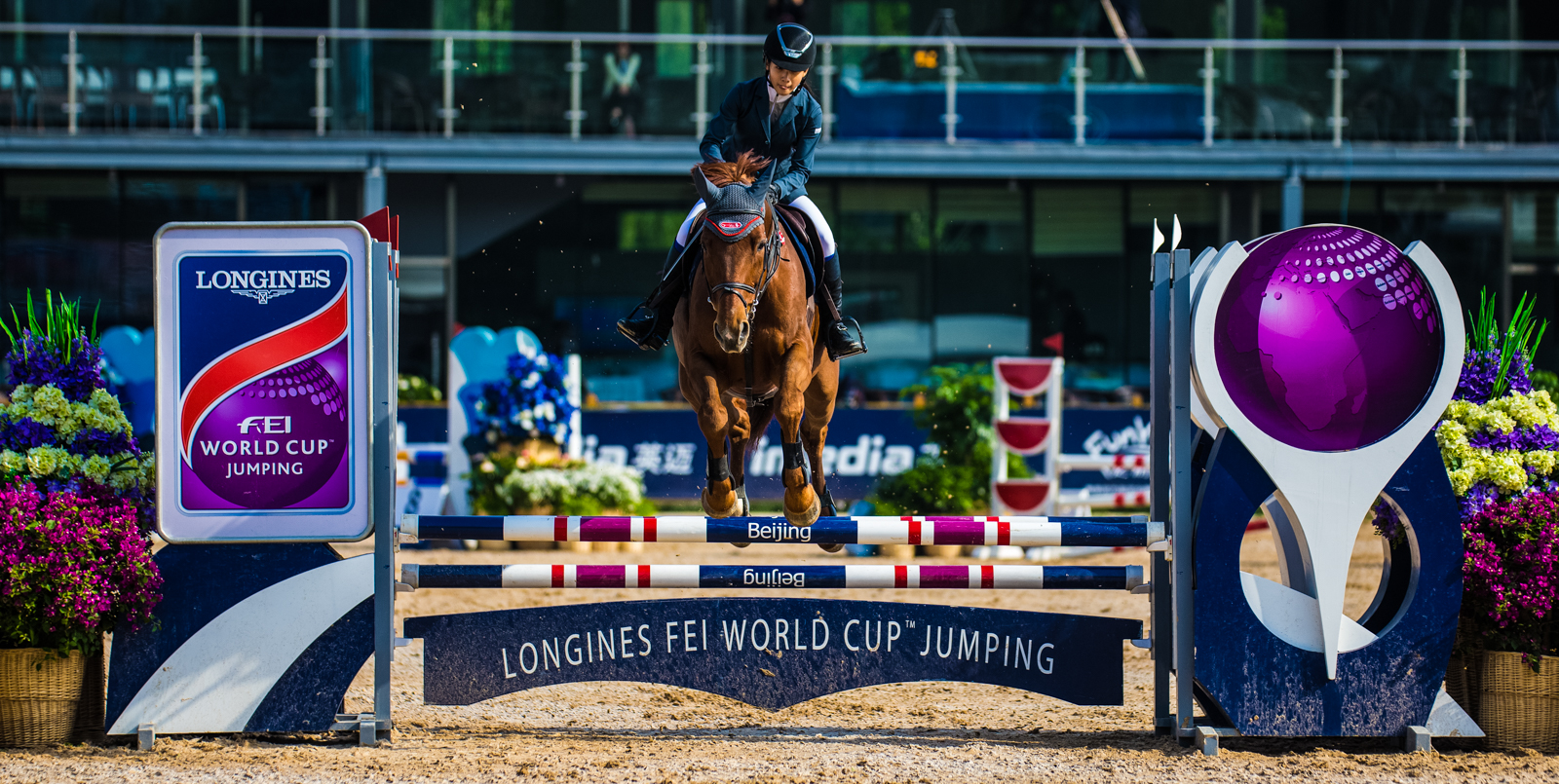 Feng Zhiqi of China rides Juicy Boy during the Longines FEI World Cup Jumping - China League at Chaoyang Park on May 8, 2016 in Beijing, China.