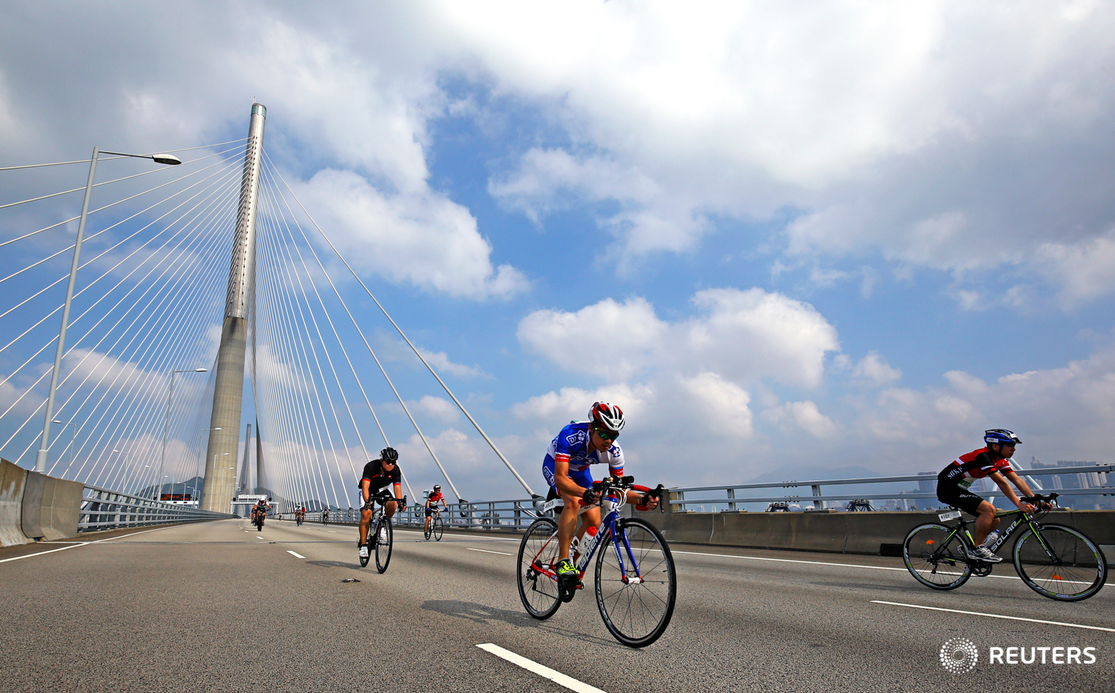 Cycling - Hong Kong Cyclothon 2016 - Hong Kong - 25/09/16 Competitors in action during 30 km Ride. The Hong Kong Cyclothon is the biggest cycling event in Hong Kong and features four races and five cycling activities. REUTERS/Yong Teck Lim