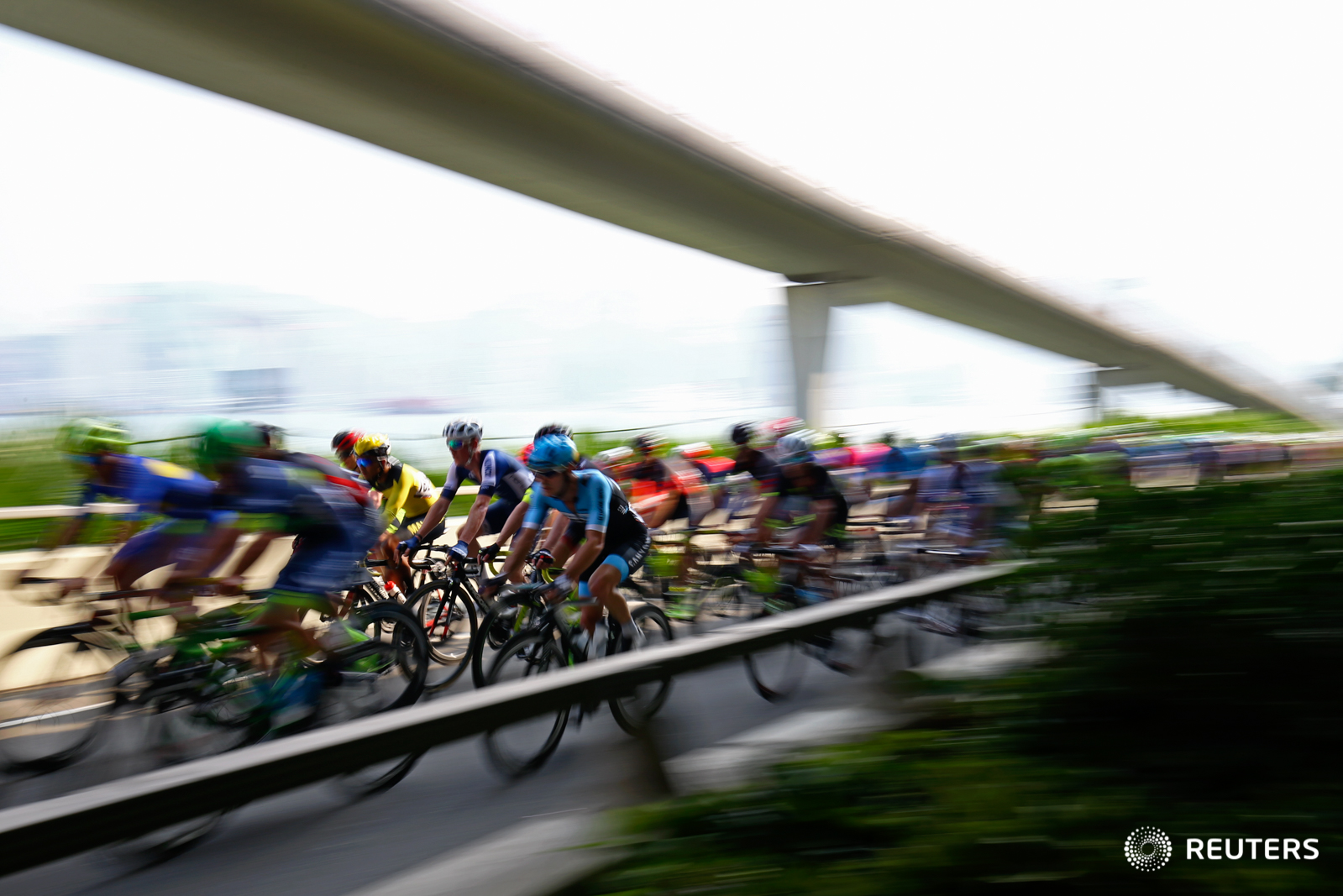 Cycling - Hong Kong Cyclothon 2016 - Hong Kong - 25/09/16 Competitors in action during the International Criterium. The Hong Kong Cyclothon is the biggest cycling event in Hong Kong and features four races and five cycling activities. REUTERS/Yong Teck Lim