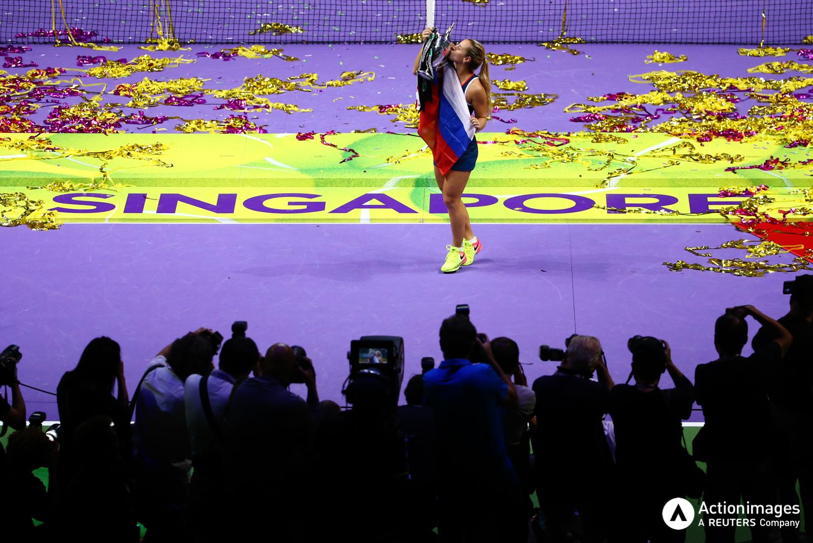 Tennis - BNP Paribas WTA Finals - Singapore Indoor Stadium - 30/10/16 Slovakia's Dominika Cibulkova celebrates winning the final with the Billie Jean King Trophy Mandatory Credit: Action Images / Yong Teck Lim Livepic