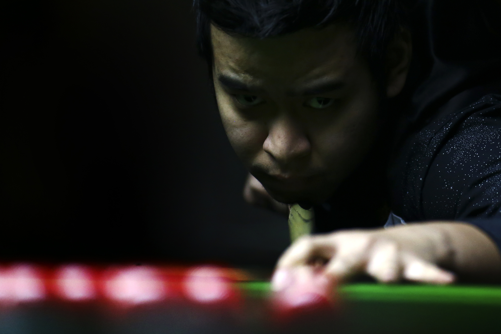 Noppon Saengkham of Thailand competes in the final during the Singapore Snooker Open at the SAFRA Toa Payoh Clubhouse on December 23, 2016 in Singapore.