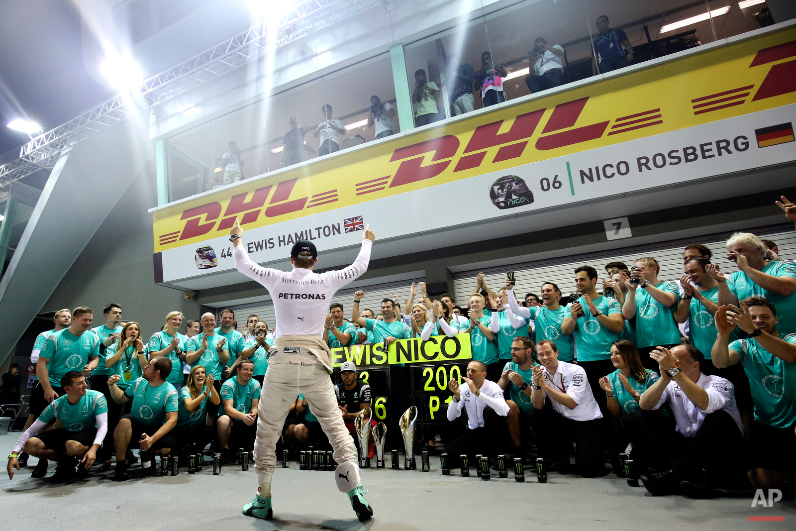 Mercedes driver Nico Rosberg of Germany celebrates with his team after winning the Singapore Formula One Grand Prix on the Marina Bay City Circuit Singapore, Sunday, Sept. 18, 2016. (AP Photo/Yong Teck Lim)