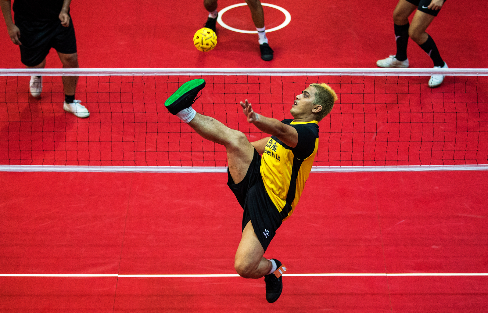 Muhammad Noh of Toa Payoh West Balestier B competes against Marsiling CSC B during the sepak takraw competition of the Singapore National Games on August 5, 2016, in Singapore.