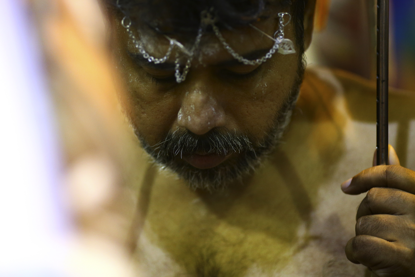 A devotee reacts as he gets his body pierced during the Thaipusam festival at the Sri Srinivasa Perumal Temple on February 9, 2017 in Singapore.