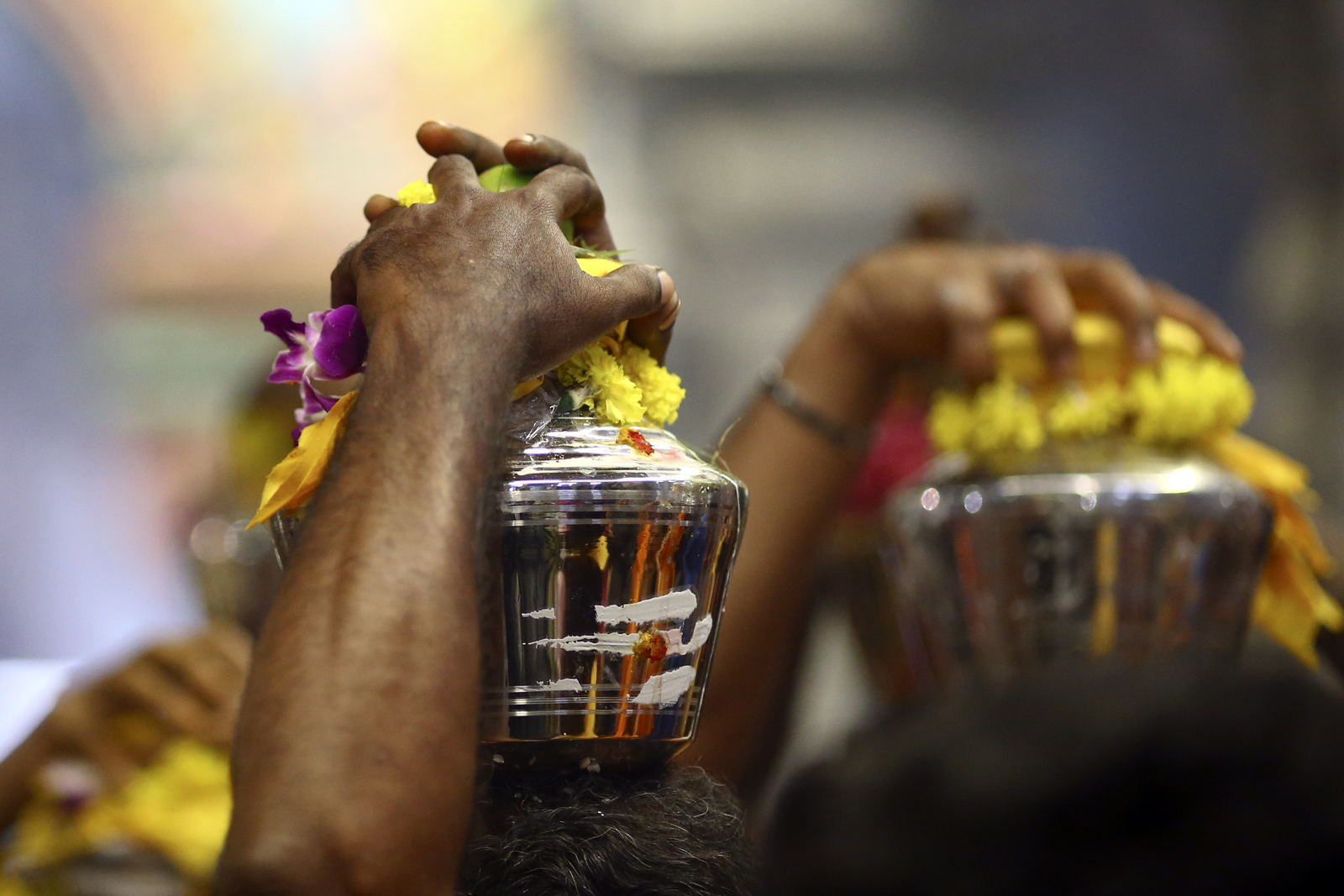 Devotees carry milk pots during the Thaipusam festival at the Sri Srinivasa Perumal Temple on February 9, 2017 in Singapore.