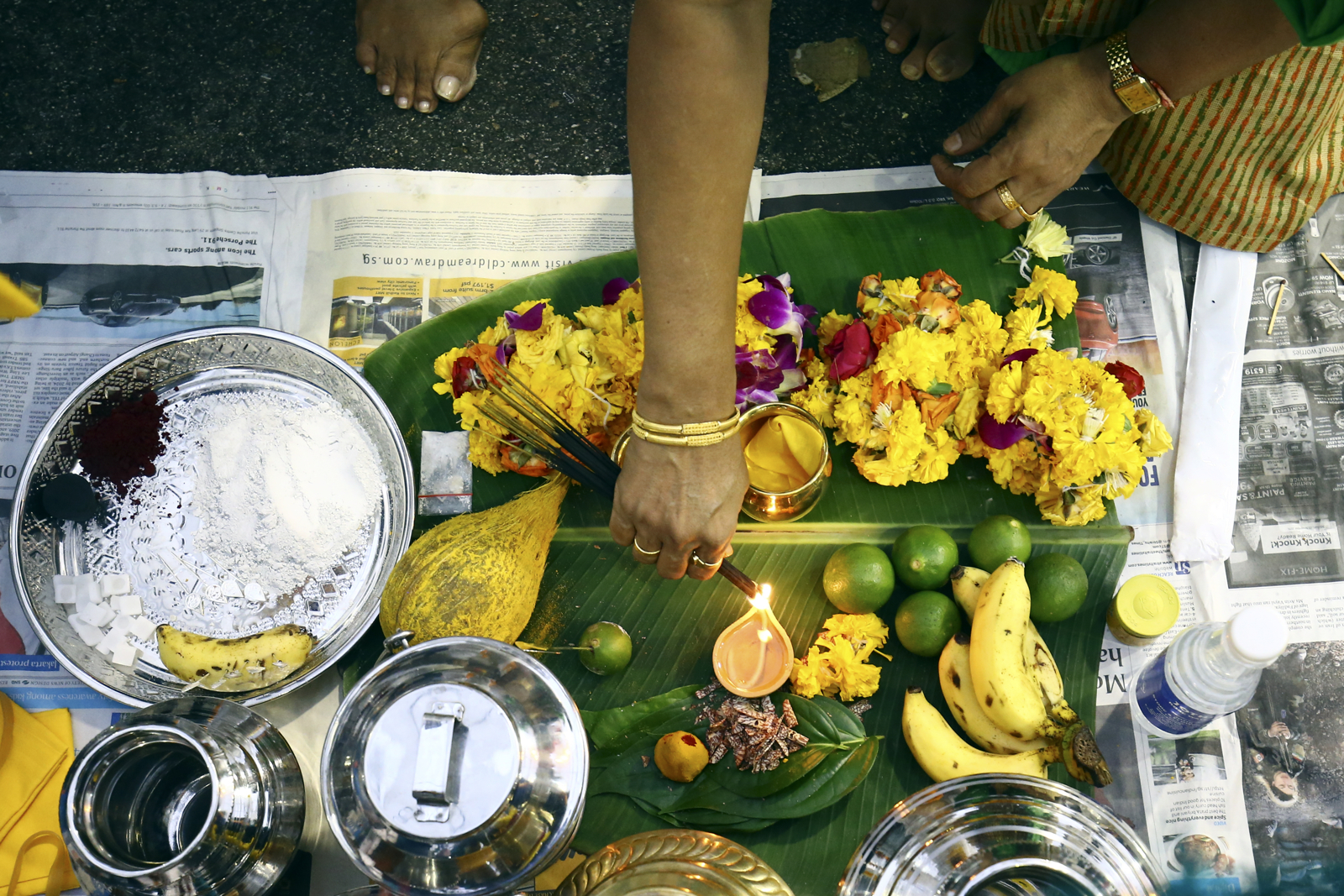 Devotees make offerings during the Thaipusam festival at the Sri Srinivasa Perumal Temple on February 9, 2017 in Singapore.
