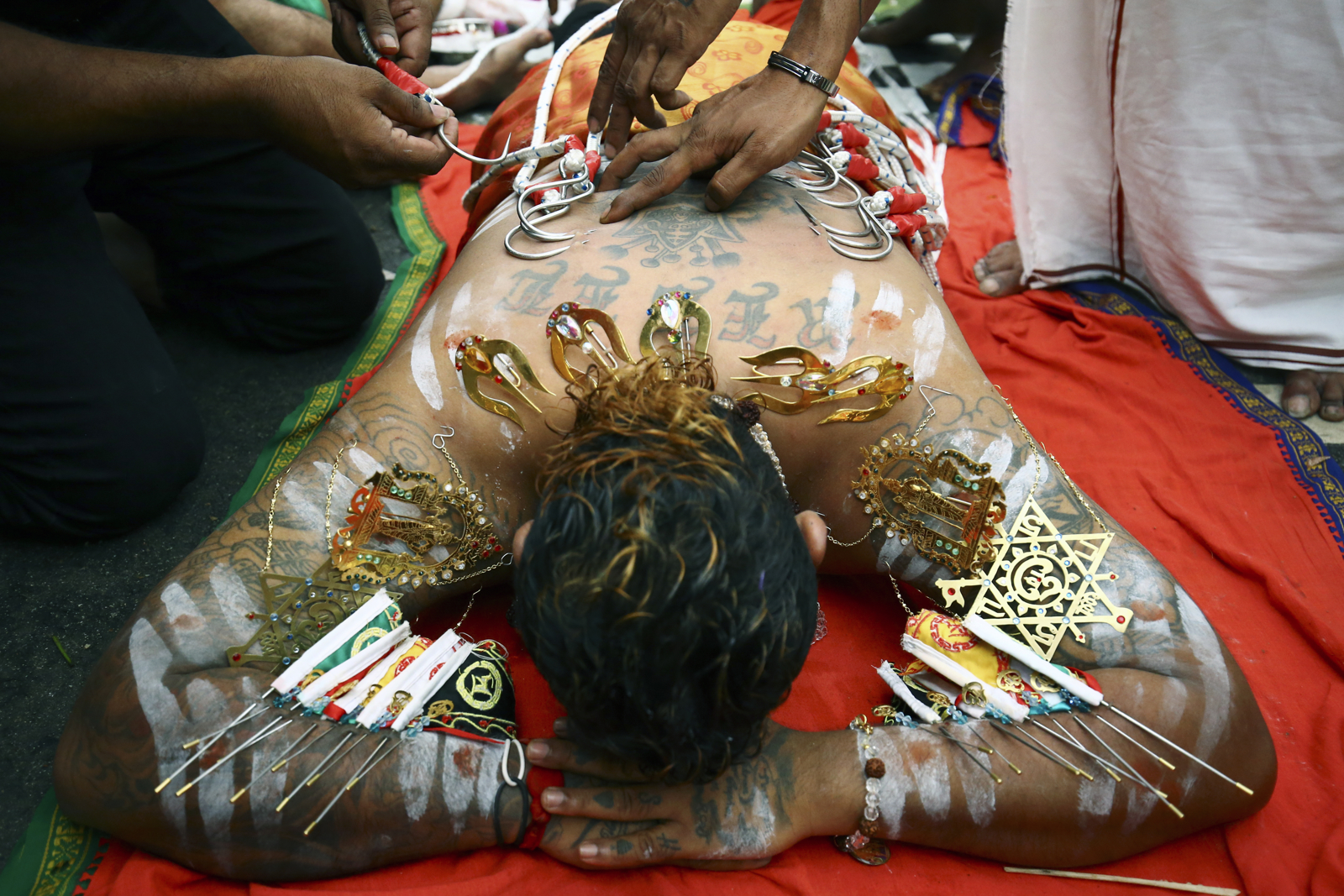 A devotee has his back pierced during the Thaipusam festival at the Sri Srinivasa Perumal Temple on February 9, 2017 in Singapore.