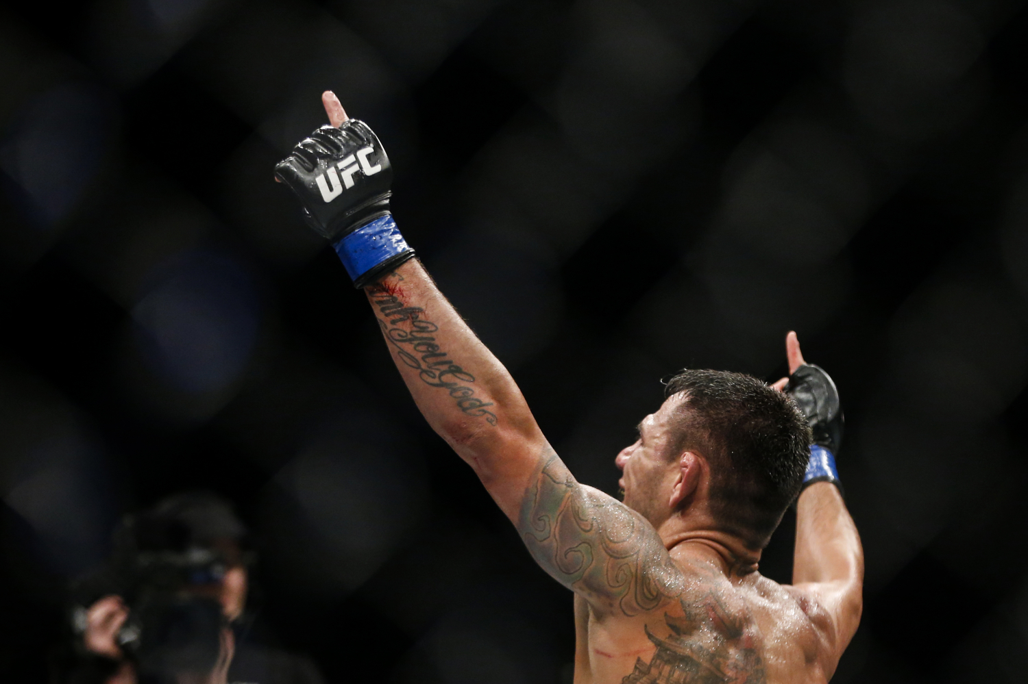 Rafael dos Anjos of Brazil celebrates his welterweight bout win over Tarec Saffiedine of Belgium at the UFC Fight Night at the Singapore Indoor Stadium on June 17, 2017.