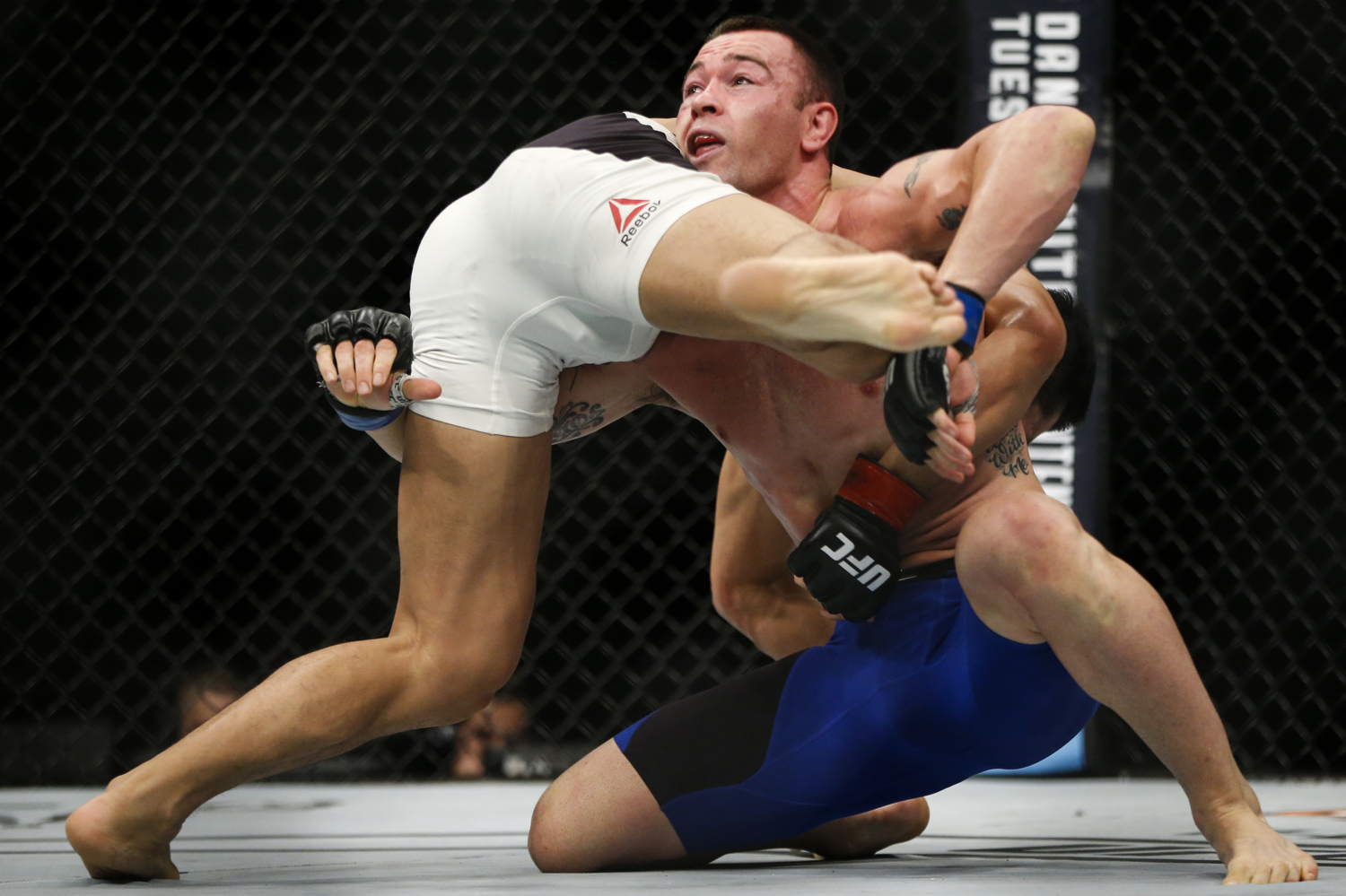 Colby Covington (R) of the United States fights with Dong Hyun Kim of South Korea during their welterweight bout at the UFC Fight Night at the Singapore Indoor Stadium on June 17, 2017.