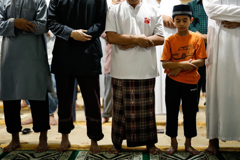 Muslims take part in tarawih prayers at Masjid Al-Mukminin.