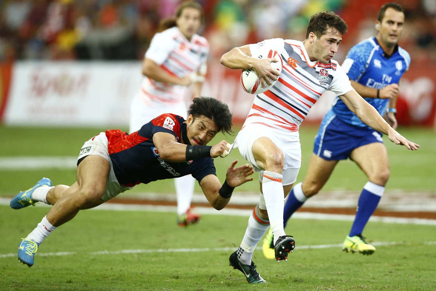 Rugby Union - Singapore Sevens - National Stadium, Singapore, 15/04/17 - England's Oliver Lindsay-Hague is tackled by Japan's Dai Ozawa. REUTERS/Yong Teck Lim
