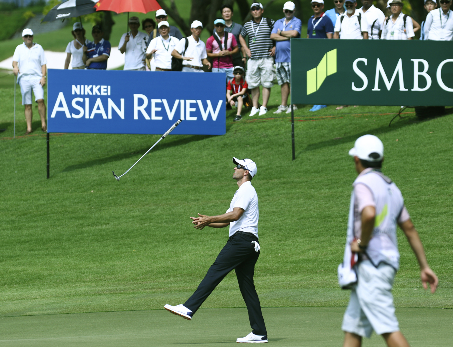 Adam Scott of Australia throws his putter after missing a putt on the ninth hole during the first round of the SMBC Singapore Open golf tournament at Sentosa's Serapong golf course in Singapore January 19, 2017.