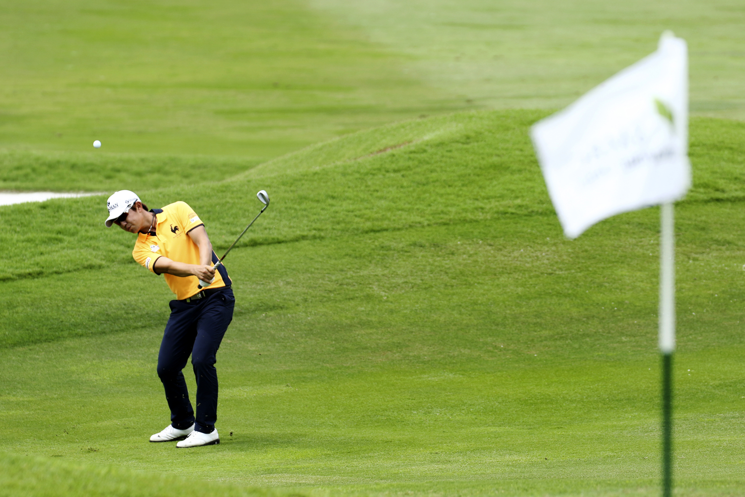 Song Younghan of South Korea hits a shot on the 18th green during the final round of the SMBC Singapore Open golf tournament at Sentosa's Serapong golf course in Singapore January 22, 2017.