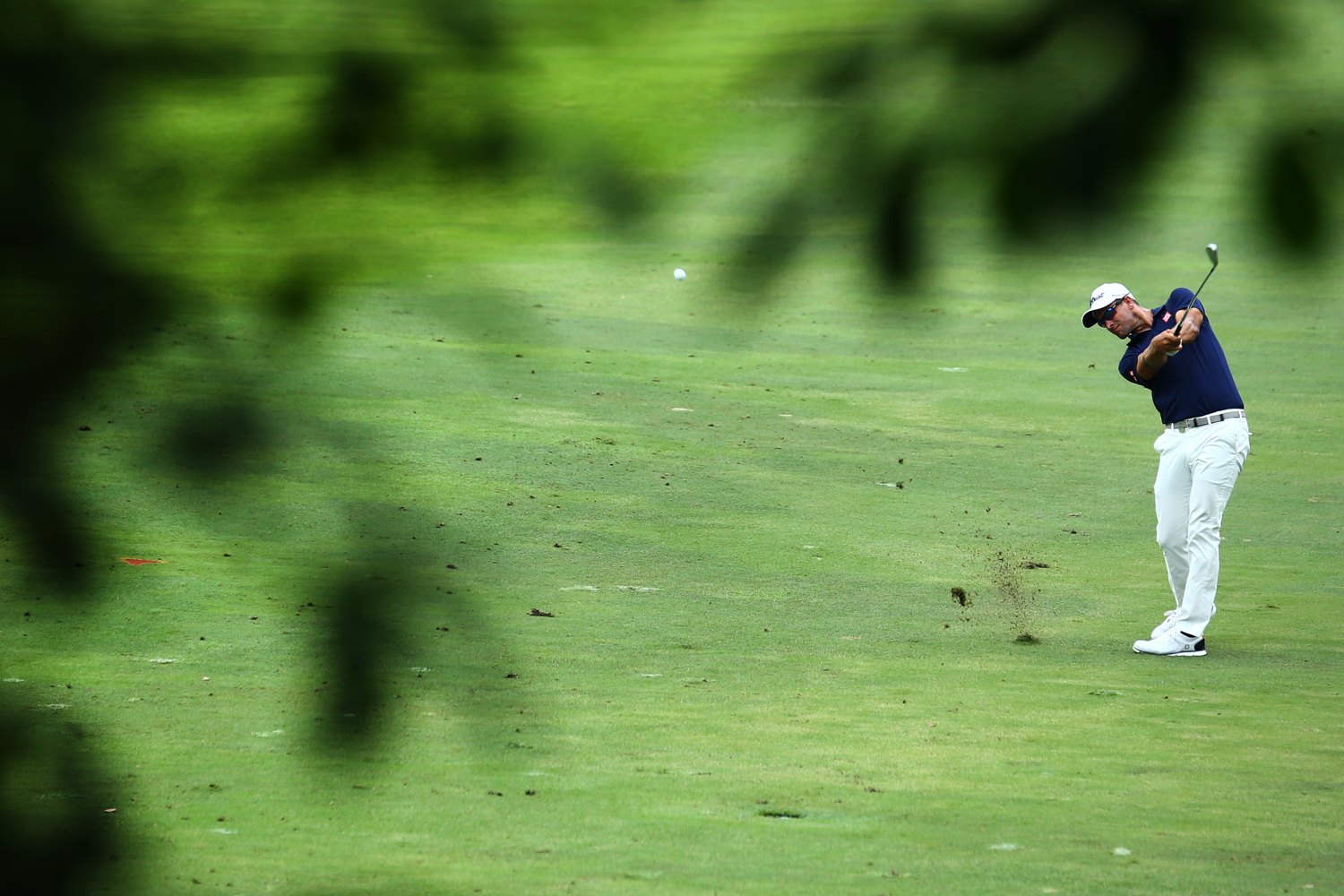 Adam Scott of Australia hits a shot on the seventh green during the second round of the SMBC Singapore Open golf tournament at Sentosa's Serapong golf course in Singapore January 20, 2017.