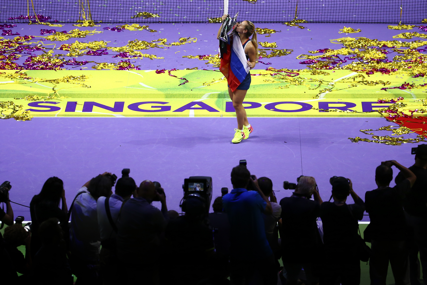 Tennis - BNP Paribas WTA Finals - Singapore Indoor Stadium - 30/10/16 Slovakia's Dominika Cibulkova celebrates with the Billie Jean King Trophy Mandatory Credit: Action Images / Yong Teck Lim Livepic EDITORIAL USE ONLY.
