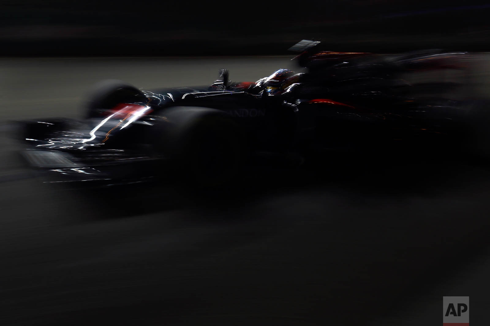 McLaren driver Fernando Alonso of Spain steers his car during the second practice session for the Singapore Formula One Grand Prix on the Marina Bay City Circuit in Singapore, Friday, Sept. 16, 2016. (AP Photo/Yong Teck Lim)