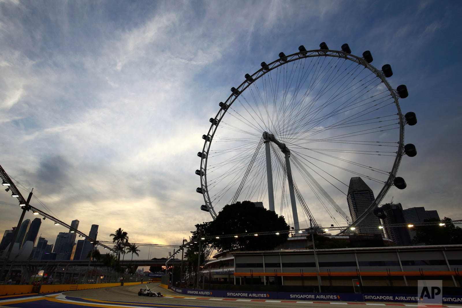 Mercedes driver Nico Rosberg of Germany steers his car during the third practice session for the Singapore Formula One Grand Prix on the Marina Bay City Circuit in Singapore, Saturday, Sept. 17, 2016. (AP Photo/Yong Teck Lim)