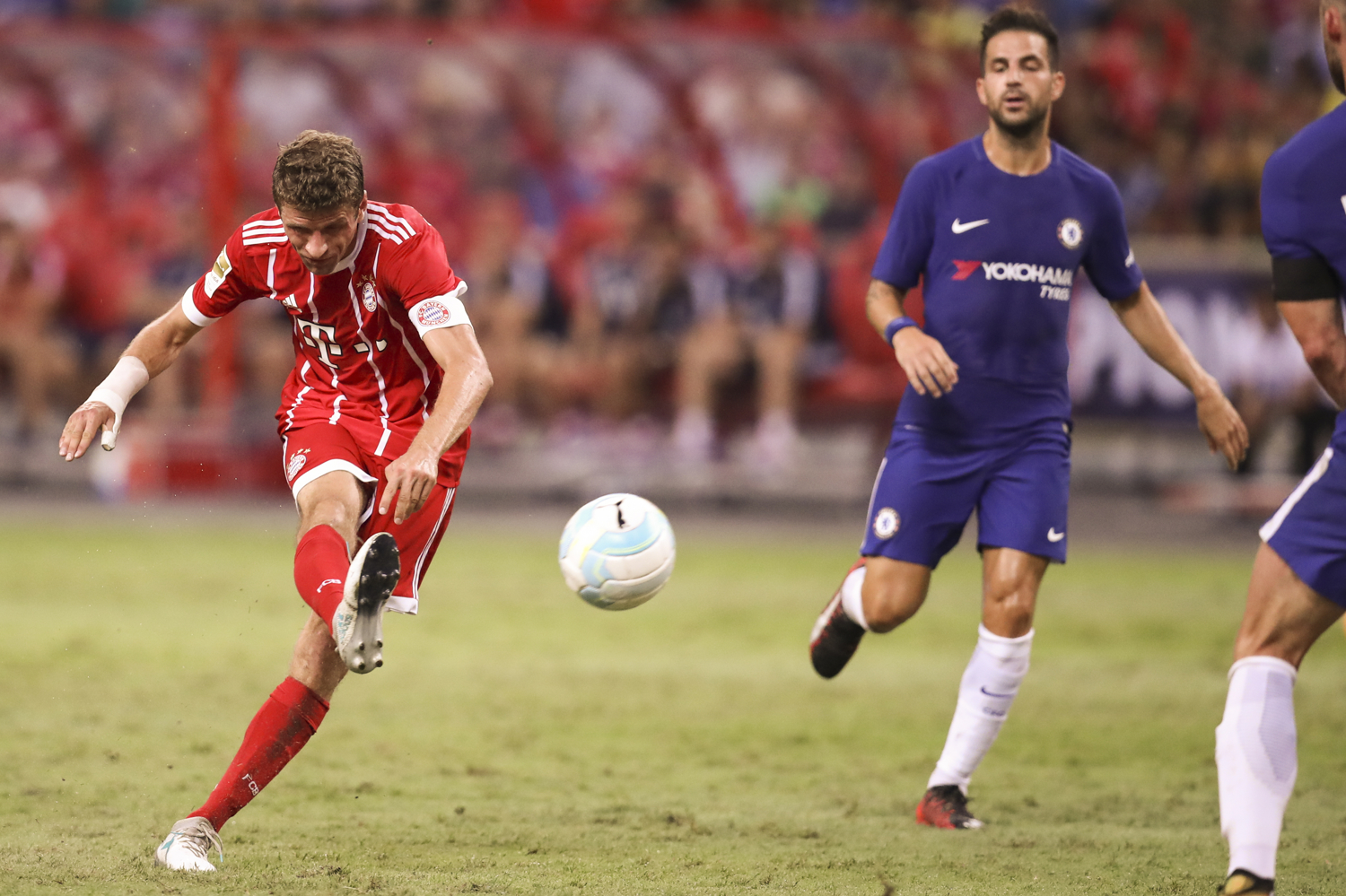 Soccer Football - Chelsea vs Bayern Munich - International Champions Cup - Singapore - July 25, 2017 Bayern Munich's Thomas Muller scores the third goal for his side REUTERS/Yong Teck Lim