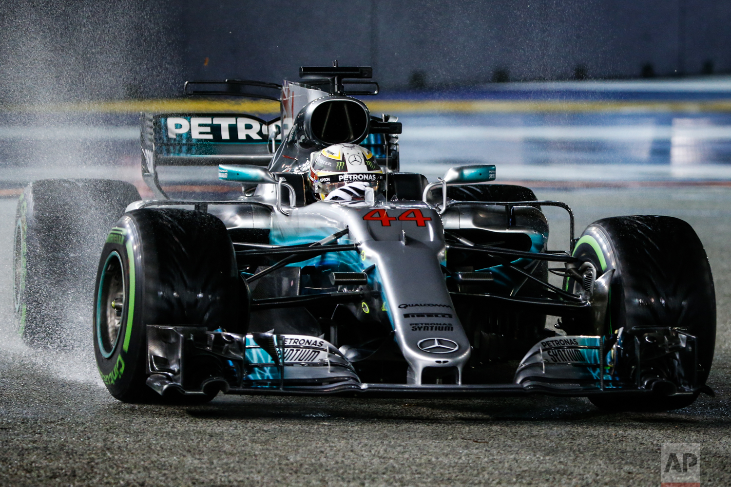Mercedes driver Lewis Hamilton of Britain steers his car during the Singapore Formula One Grand Prix on the Marina Bay City Circuit Singapore, Sunday, Sept. 17, 2017. (AP Photo/Yong Teck Lim)