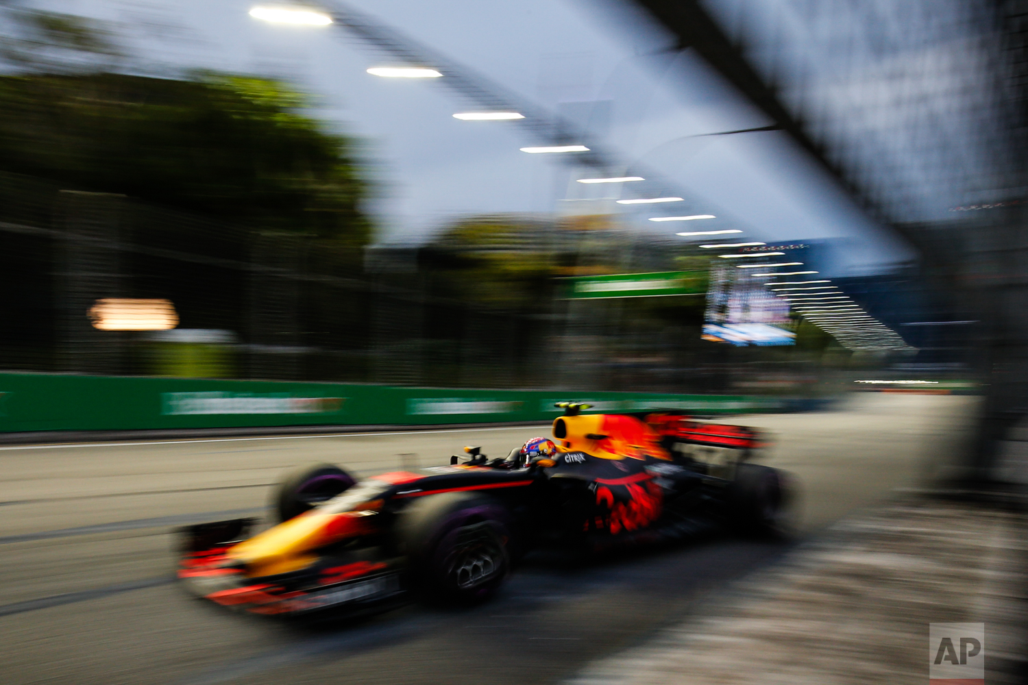Red Bull driver Max Verstappen of the Netherlands steers his car during the third practice session at the Singapore Formula One Grand Prix on the Marina Bay City Circuit Singapore, Saturday, Sept. 16, 2017. (AP Photo/Yong Teck Lim)