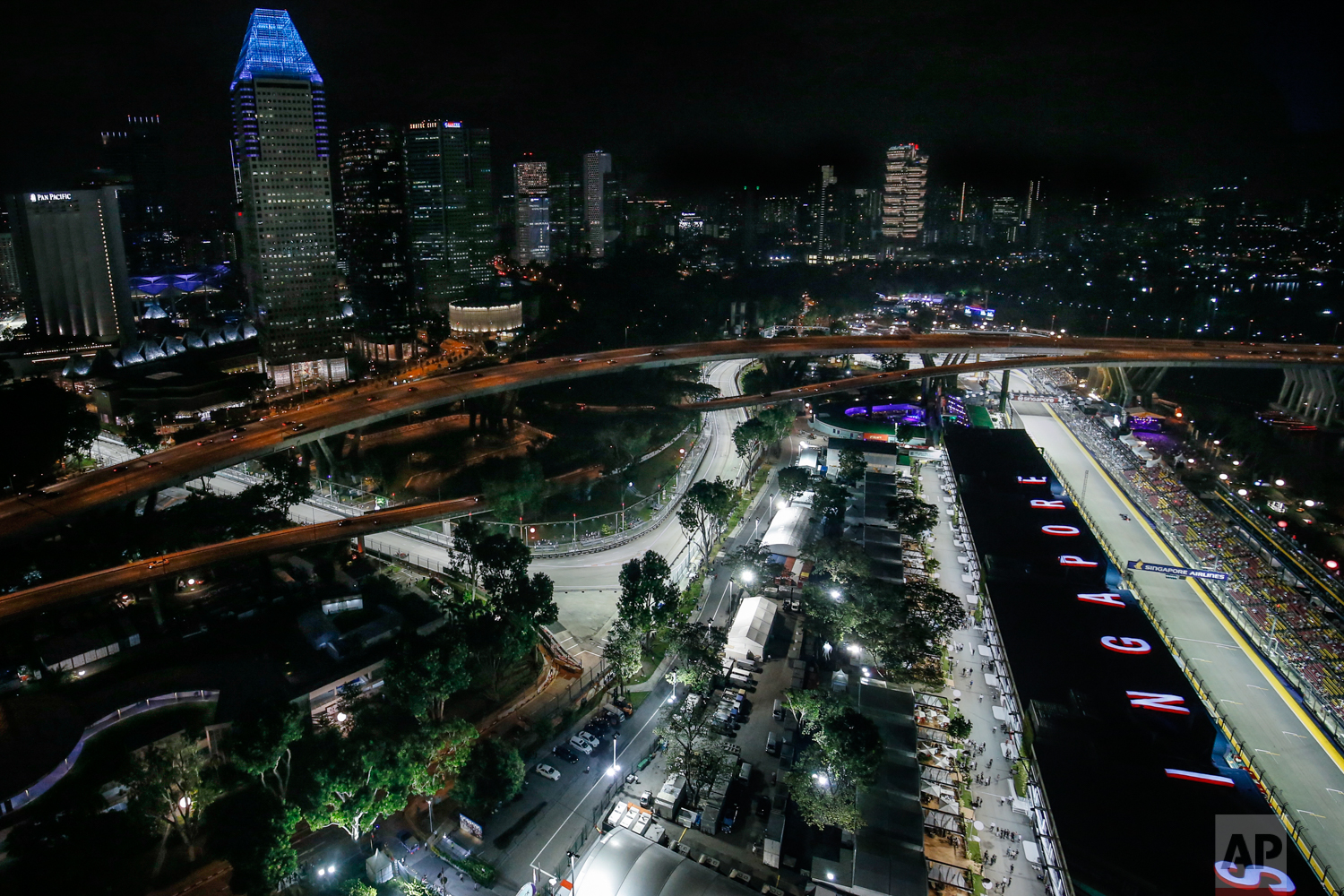 The Singapore F1 Grand Prix's Marina Bay City Circuit is lit during the second practice session at the Singapore Formula One Grand Prix on the Marina Bay City Circuit Singapore, Friday, Sept. 15, 2017. (AP Photo/Yong Teck Lim)