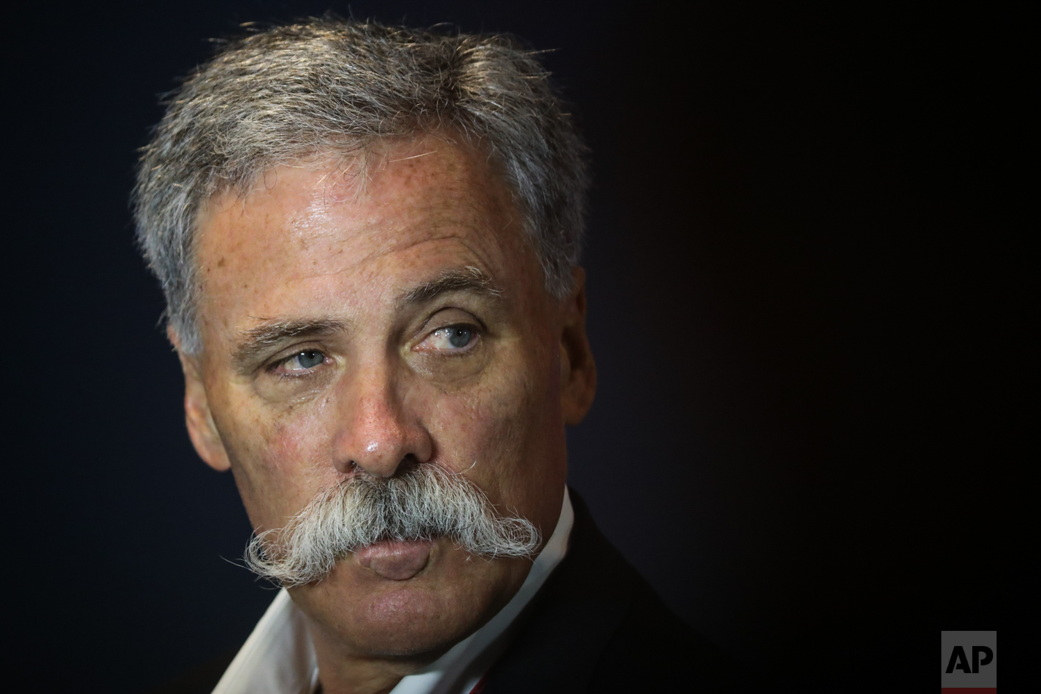 F1 President Chase Carey waits for the start of a press conference at the Marina Bay City Circuit ahead of the Singapore Formula One Grand Prix in Singapore on Friday, Sept. 15, 2017. (AP Photo/Yong Teck Lim)