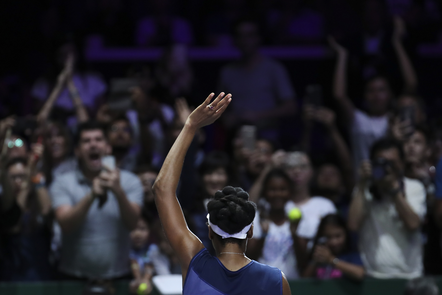 Venus Williams of the United States celebrates after beating Caroline Garcia of France during their semifinal match at the WTA tennis tournament in Singapore, on Saturday, Oct. 28, 2017. (AP Photo/Yong Teck Lim)