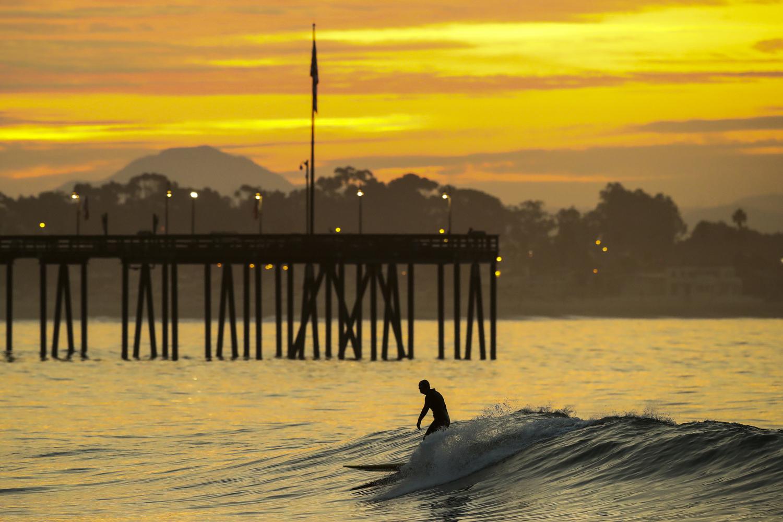 A man surfs at daybreak at Ventura Point on November 12, 2017 in Ventura, California.