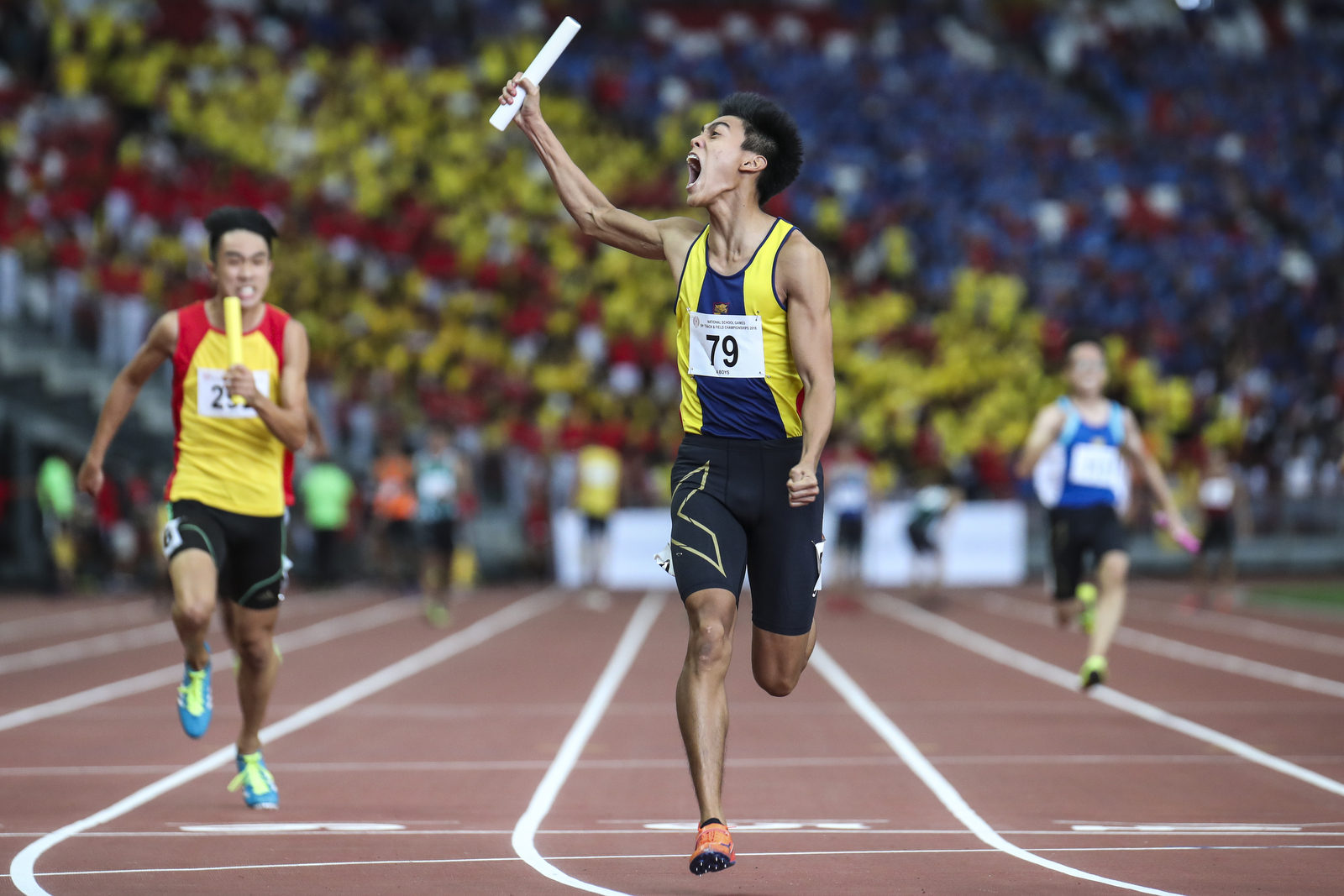 Joshua Lim of Anglo-Chinese School (Independent) celebrates after anchoring his team to win the National Schools boys' 'A' Division boys' 4x100m relay final at the National Stadium on April 12, 2018 in Singapore. (Photo © Yong Teck Lim/Red Sports)