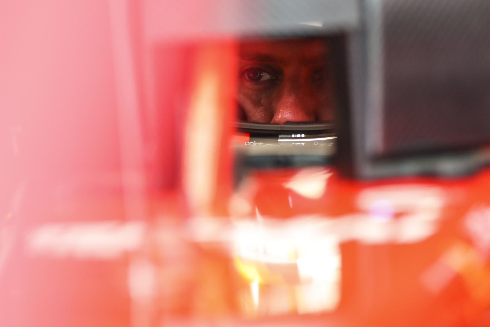 Ferrari driver Sebastian Vettel of Germany sits in his car during first practice at the Marina Bay City Circuit ahead of the Singapore Formula One Grand Prix in Singapore, Sunday, Sept. 14, 2018. (AP Photo/Yong Teck Lim)